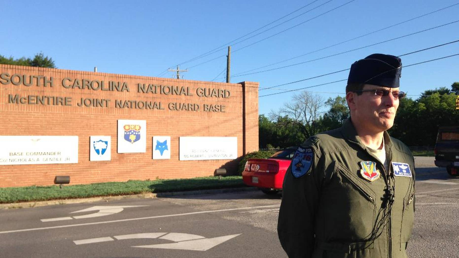 Base commander Col. Nicholas Gentile speaks with reporters outside McEntire Joint National Guard Base in Eastover, SC., Wednesday June 8, 2016. Two F-16C South Carolina Air National Guard jets collided over eastern Georgia, Tuesday evening. Gentile says the planes were totally destroyed, but the pilots ejected and survived, and have returned to South Carolina. (AP Photo/Susanne M. Schafer)