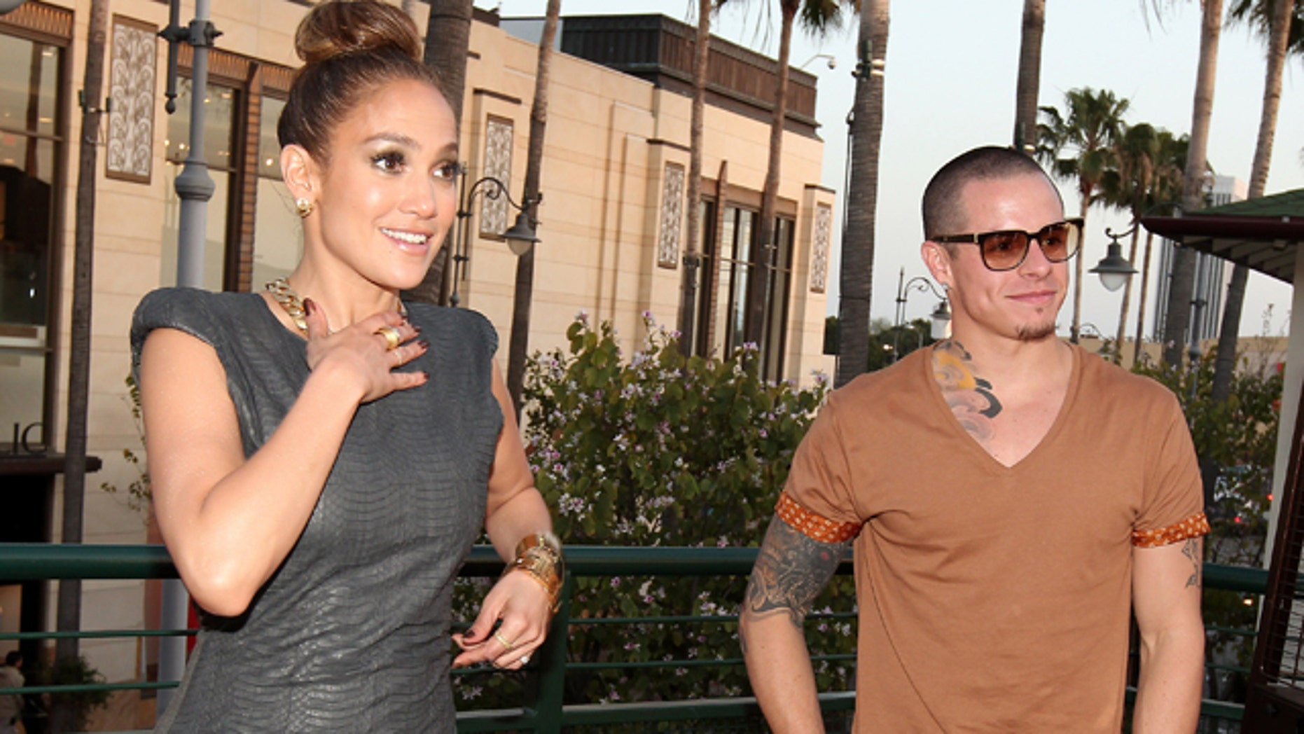 April 5, 2012: Singer/Actress Jennifer Lopez and Casper Smart attend the Planet Dailies And Mixology 101 Grand Opening held at Planet Dailies Mixology 101 in Los Angeles, California.