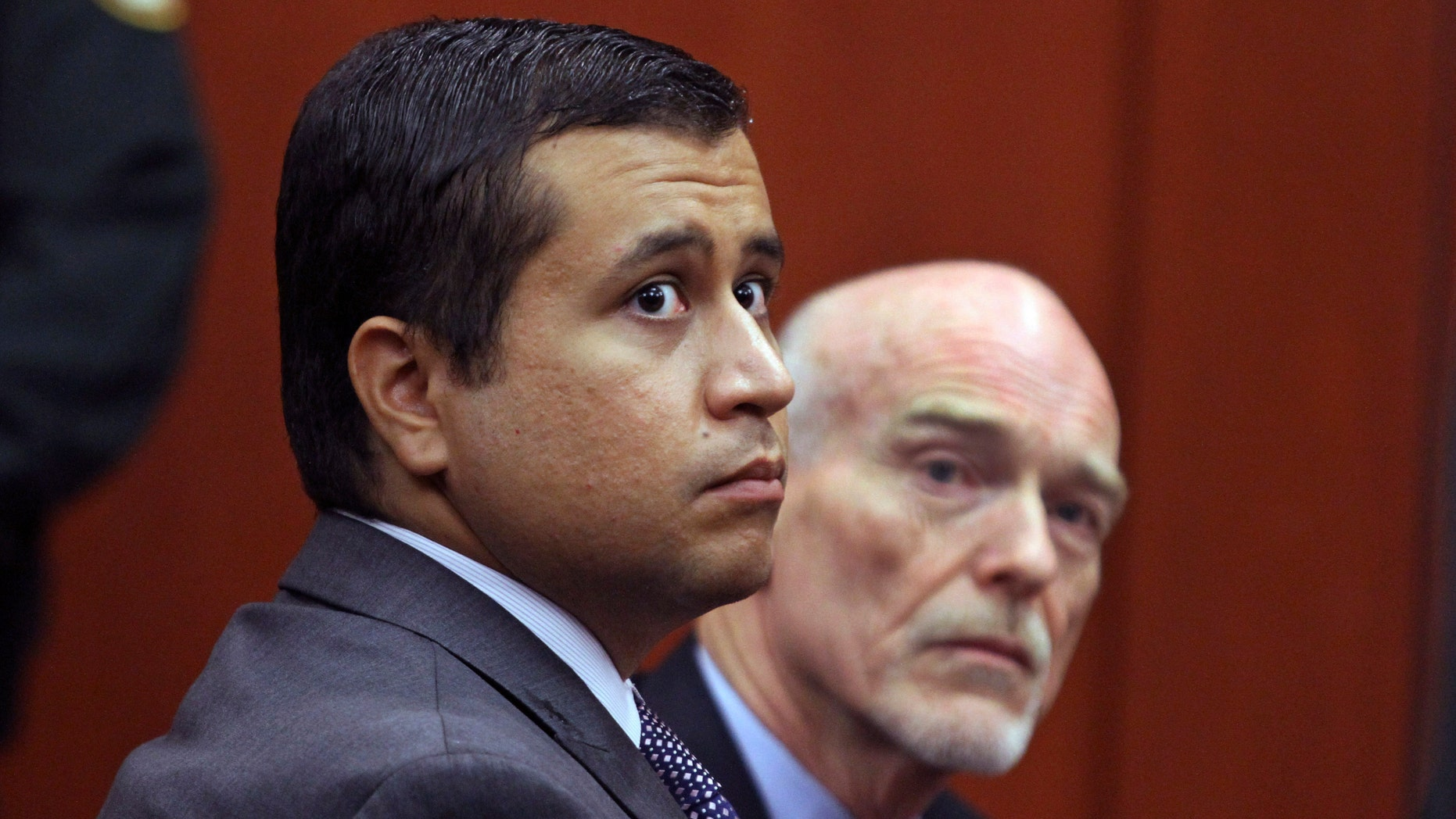 George Zimmerman, left, and attorney Don West at the Seminole County Criminal Justice Center in Sanford, Fla.