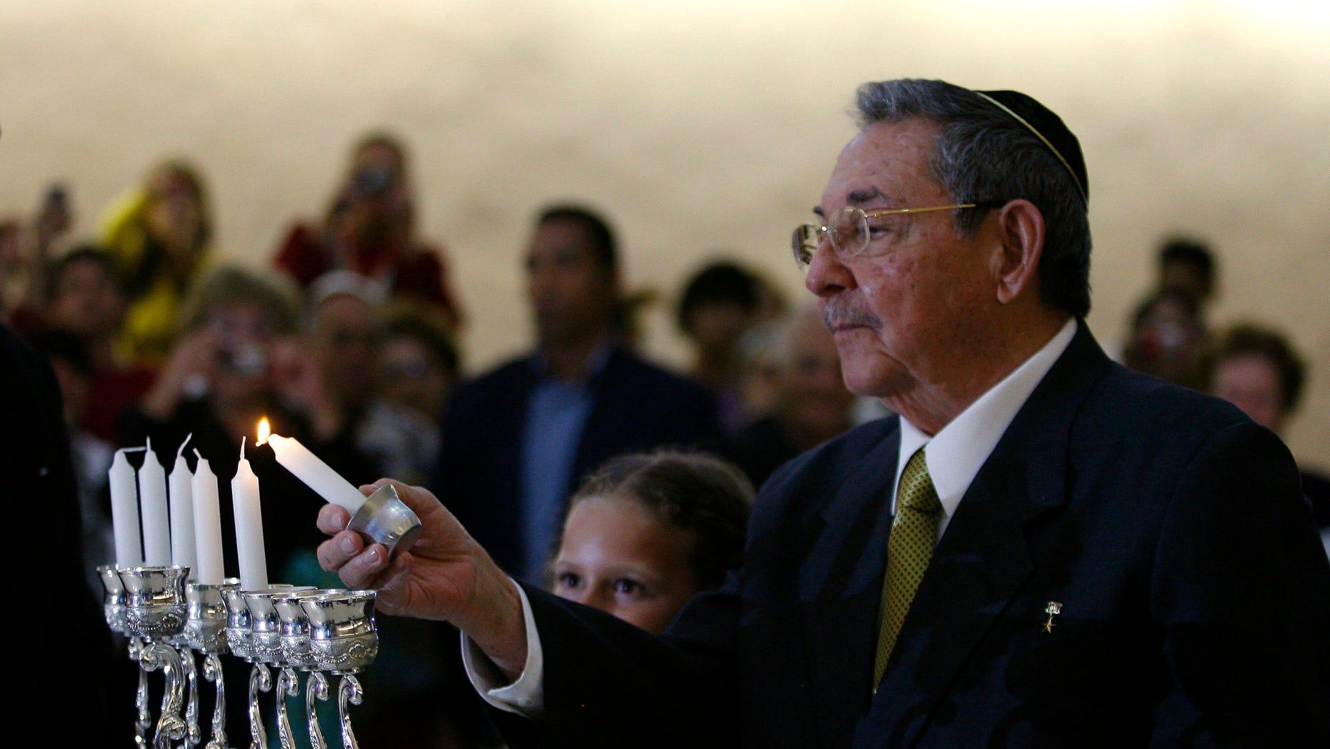 Cuba's President Raul Castro lights a Hanukkah candle during a ceremony at the Bet Shalom synagogue in Havana, Cuba, Sunday Dec. 5, 2010.  (AP Photo/Ismael Francisco, Prensa Latina)