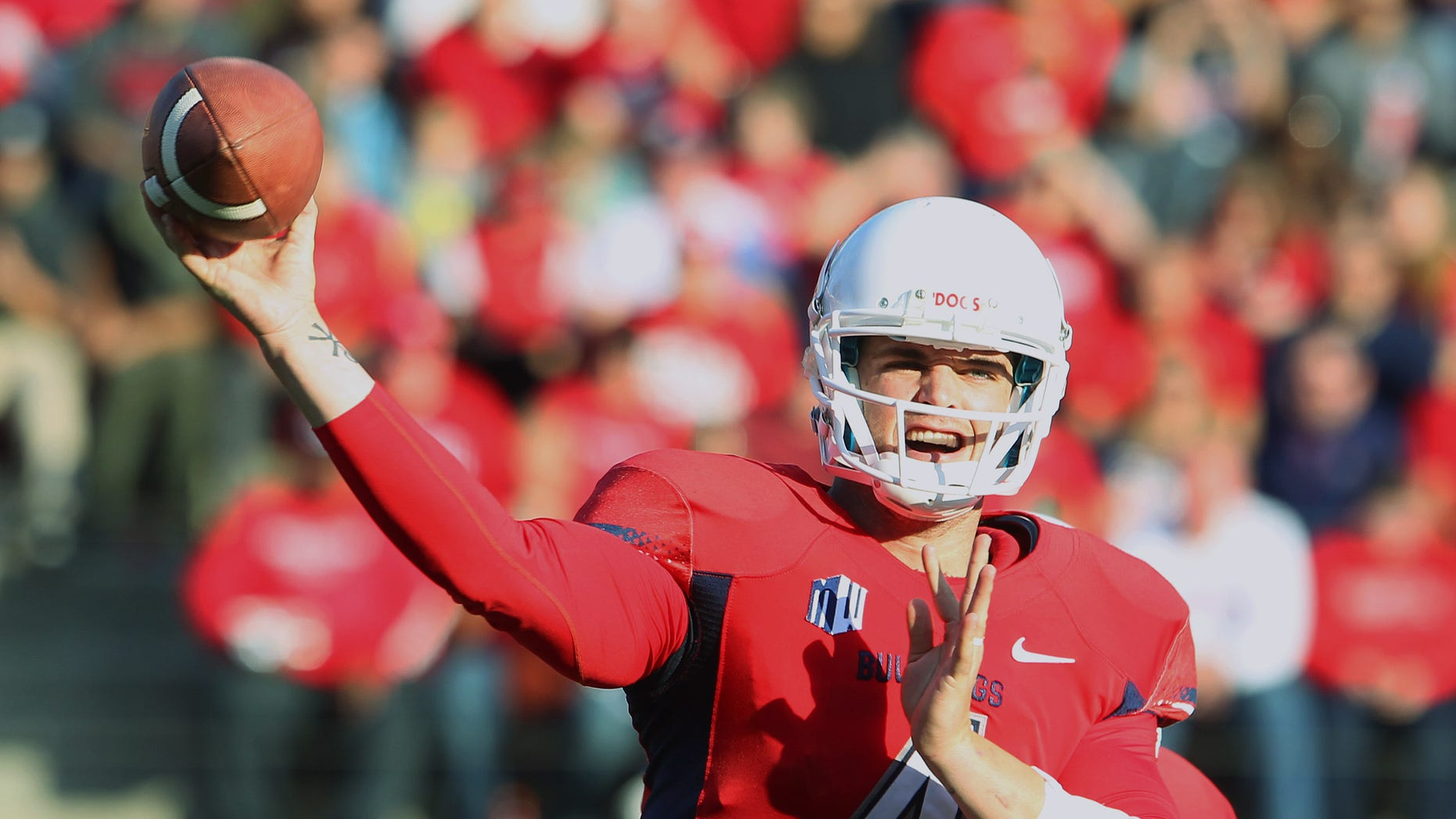 Derek Carr throws a pass against New Mexico on his way to 527 yards in the first half of an NCAA college football game in Fresno, Calif., Saturday, Nov. 23, 2013. (AP Photo/Gary Kazanjian)