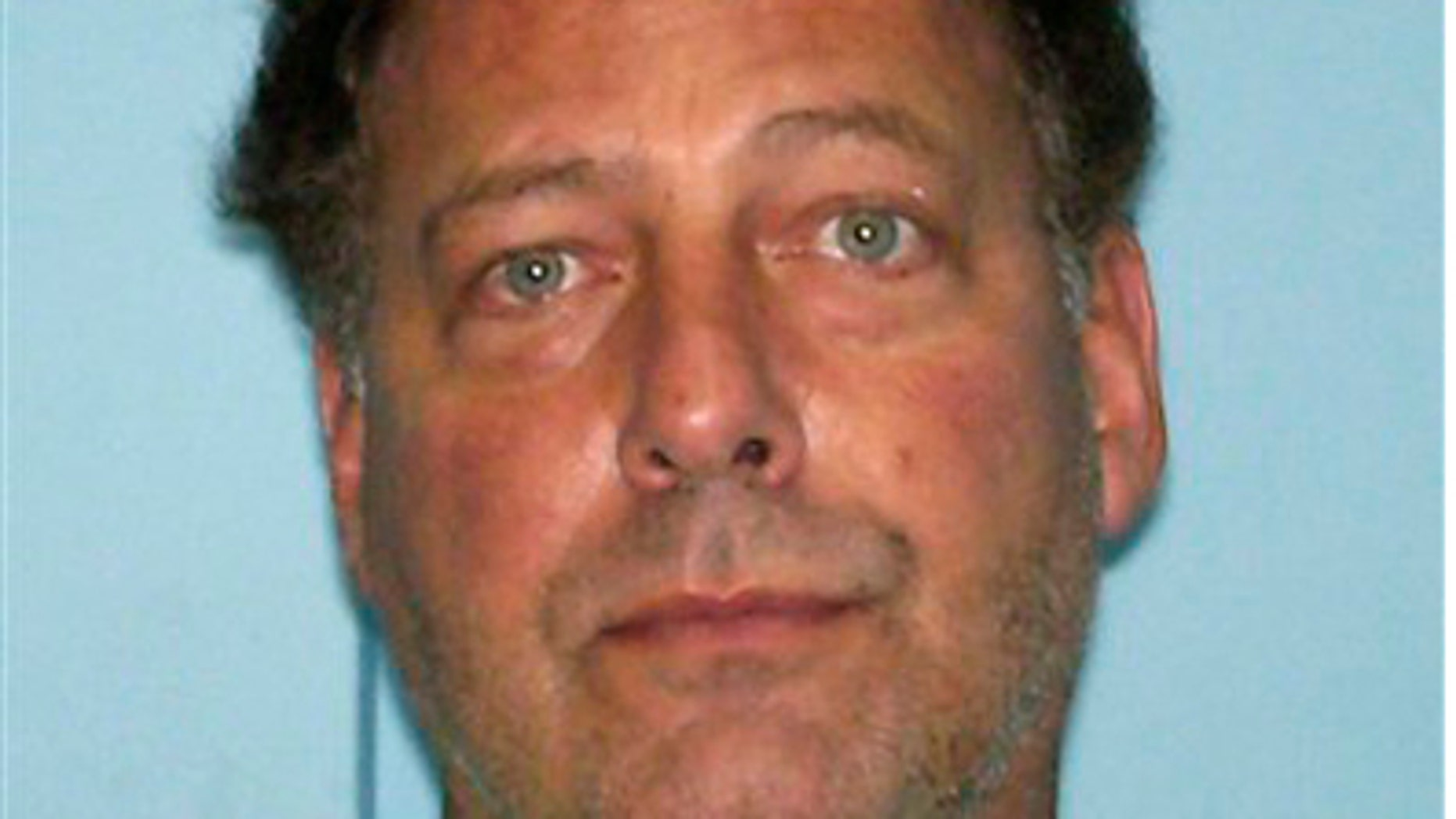 In this picture released Thursday Aug. 11, 2011, U.S. citizen Gary V. Giordano, 50, of Gaithersburg, Maryland is shown on an Aruba's police mugshot in Oranjestad, Aruba.