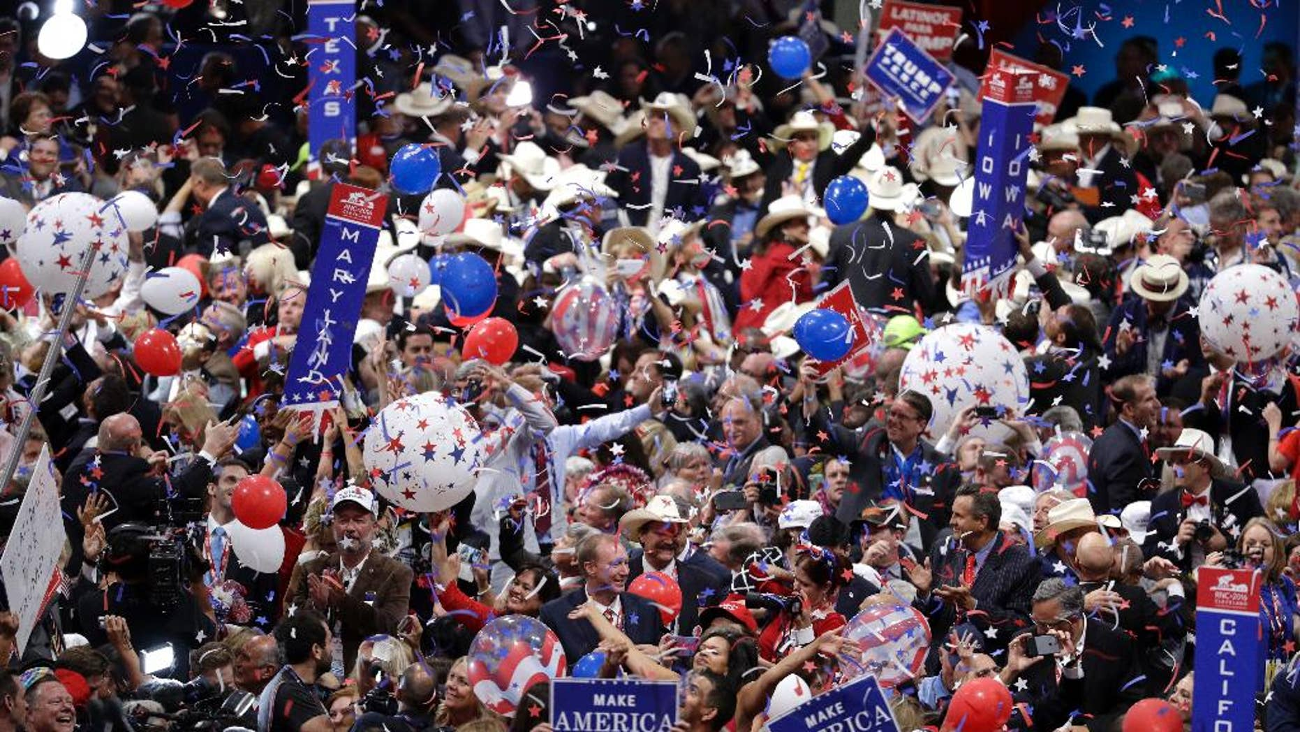Delegates celebrate as balloons fall after the speech by Republican Presidential Candidate Donald Trump during the final day of the Republican National Convention in Cleveland, Thursday, July 21, 2016. (AP Photo/John Locher)