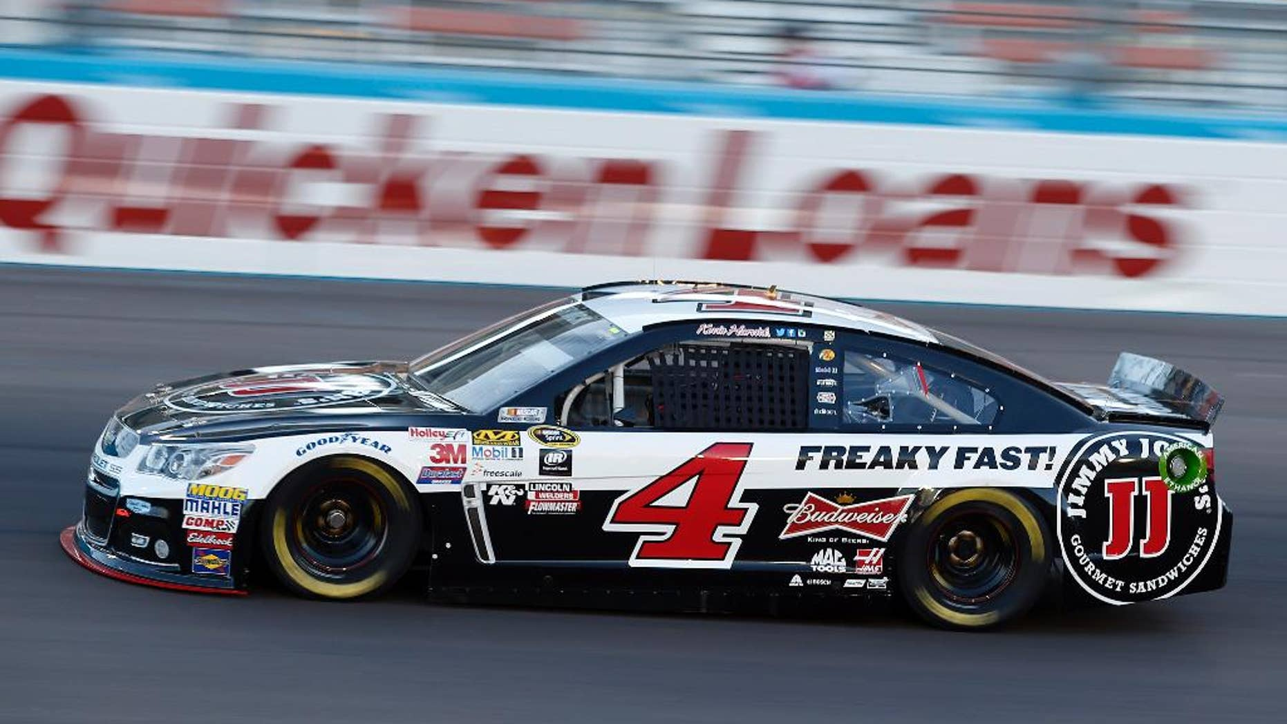 Kevin Harvick drives during qualifying for Sunday's NASCAR Sprint Cup Series auto race, Friday, March 13, 2015, in Avondale, Ariz. Harvick won the pole. (AP Photo/Rick Scuteri)