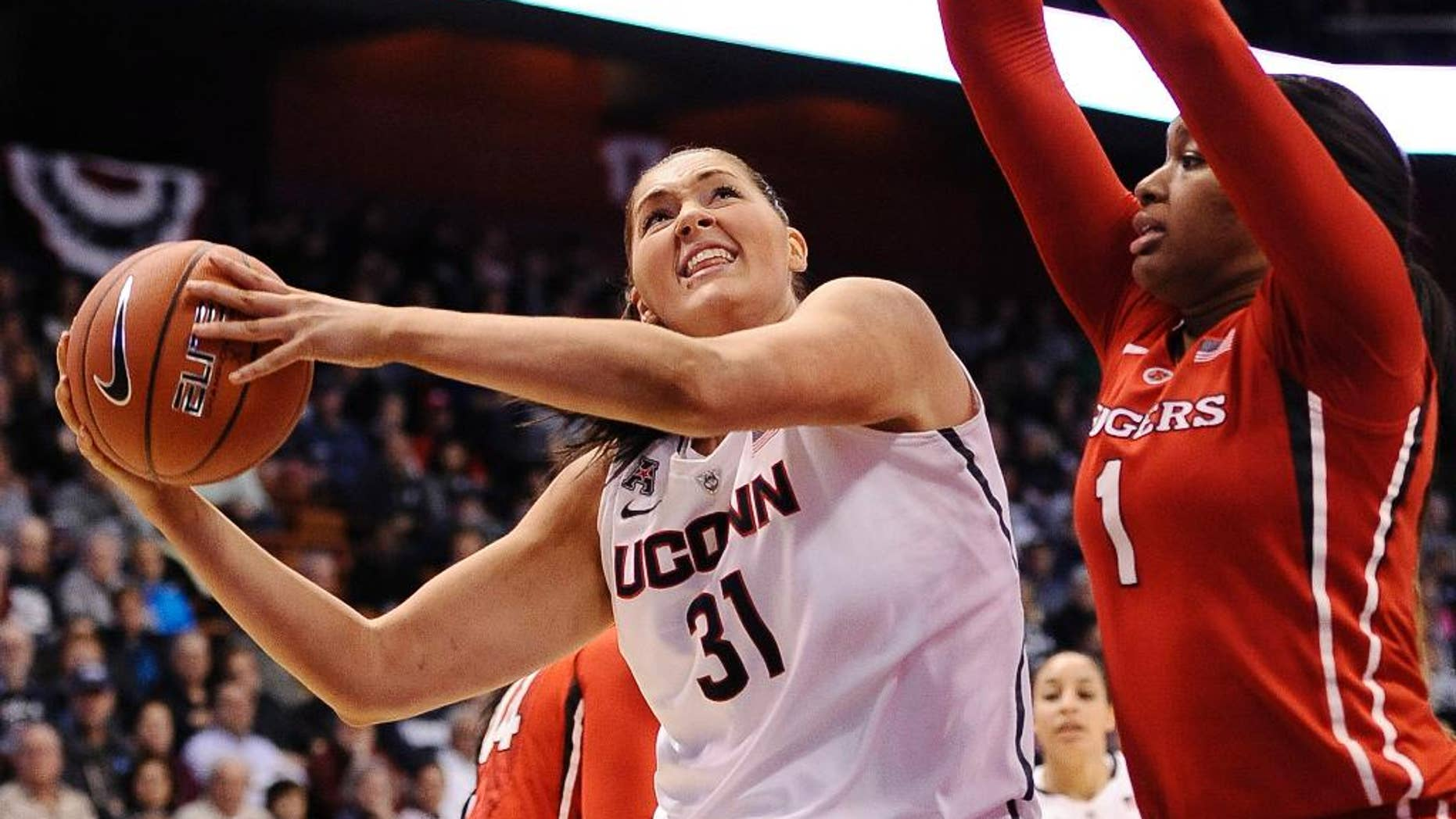 Connecticut's Stefanie Dolson (3) looks to shoot as Rutgers Rachel Hollivay, right, defends during the second half of an NCAA college basketball game in the semifinals of the American Athletic Conference women's tournament on Sunday, March 9, 2014, in Uncasville, Conn. Connecticut won 83-57. (AP Photo/Jessica Hill)