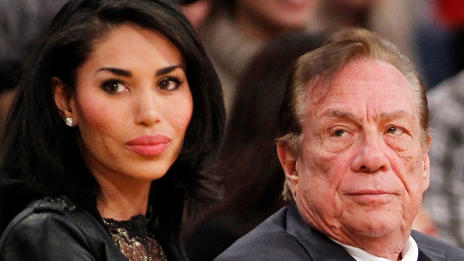 Donald Sterling and V. Stiviano in a  December 2010 file photo