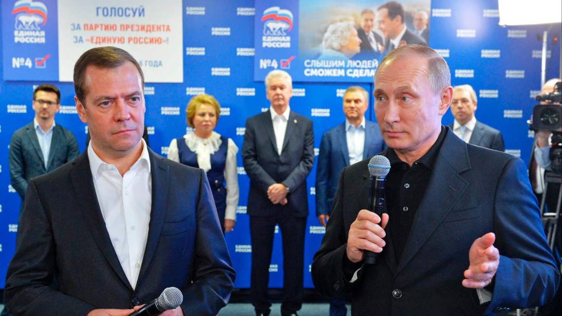 Russian President Vladimir Putin, right, and Russian Prime Minister Dmitry Medvedev, left, on Sunday.