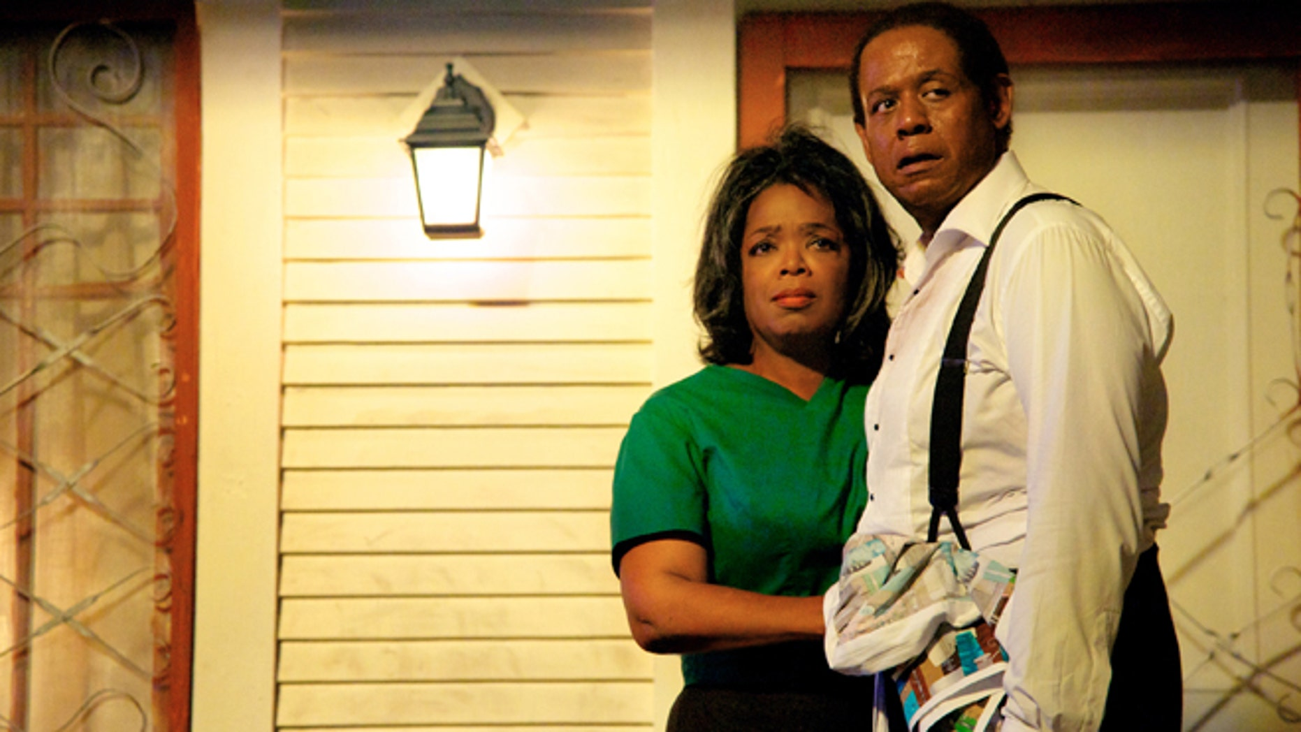 "This film image released by The Weinstein Company shows Oprah Winfrey as Gloria Gaines, left, and Forest Whitaker as Cecil Gaines in a scene from Lee Daniels' ""The Butler."""