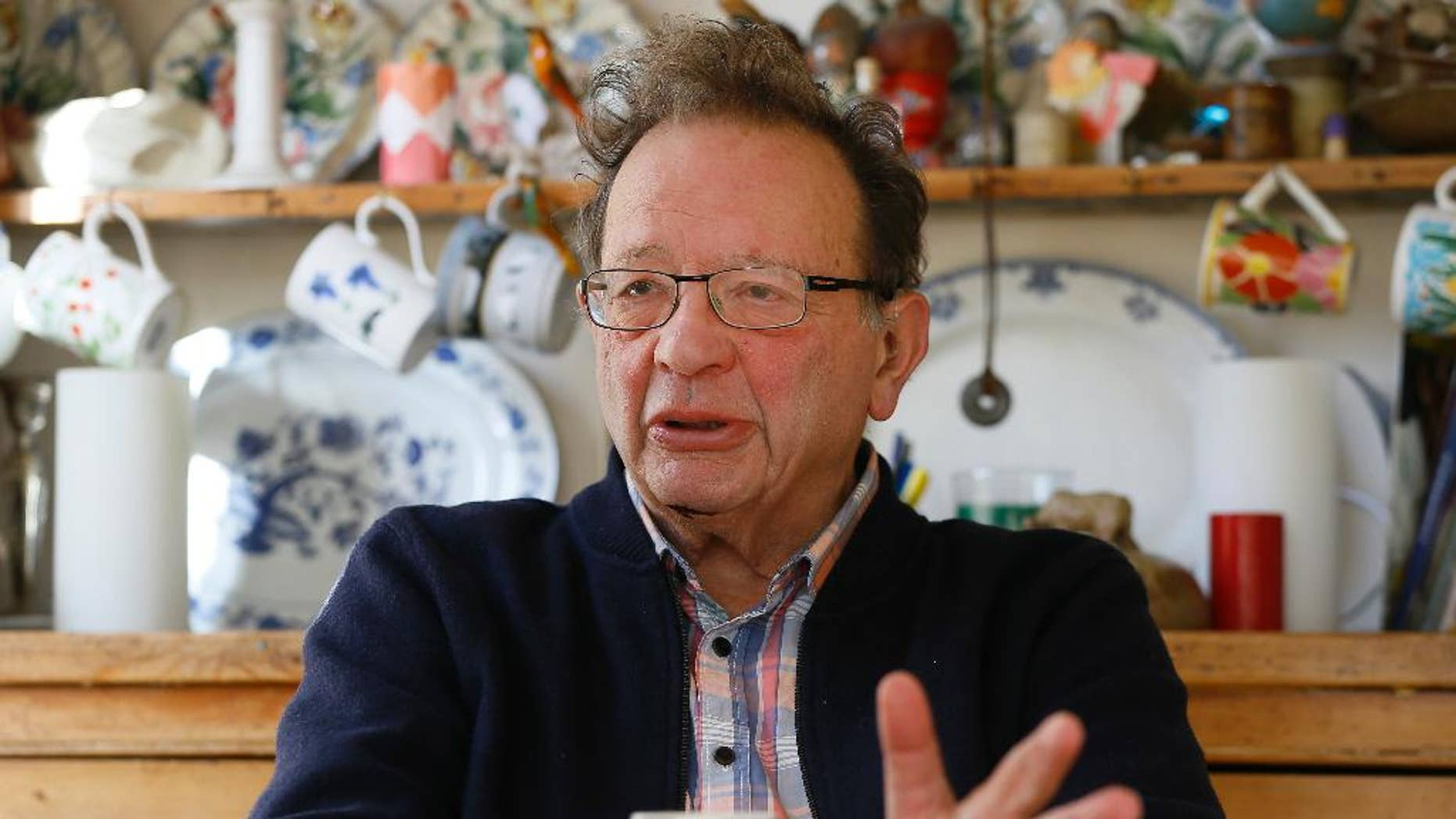 """FILE - In this Feb. 15, 2016 file photo, Larry Sanders, the brother of former U.S. presidential candidate Bernie Sanders, sits at home in his kitchen in Oxford, England. Bernie Sanders said on Tuesday, Oct. 11, 2016, that he doesn't know """"a heck of a lot"""" about British politics but that hasn't stopped him from endorsing his brother Larry Sanders' bid for a seat in Parliament. (AP Photo/Kirsty Wigglesworth, File)"""