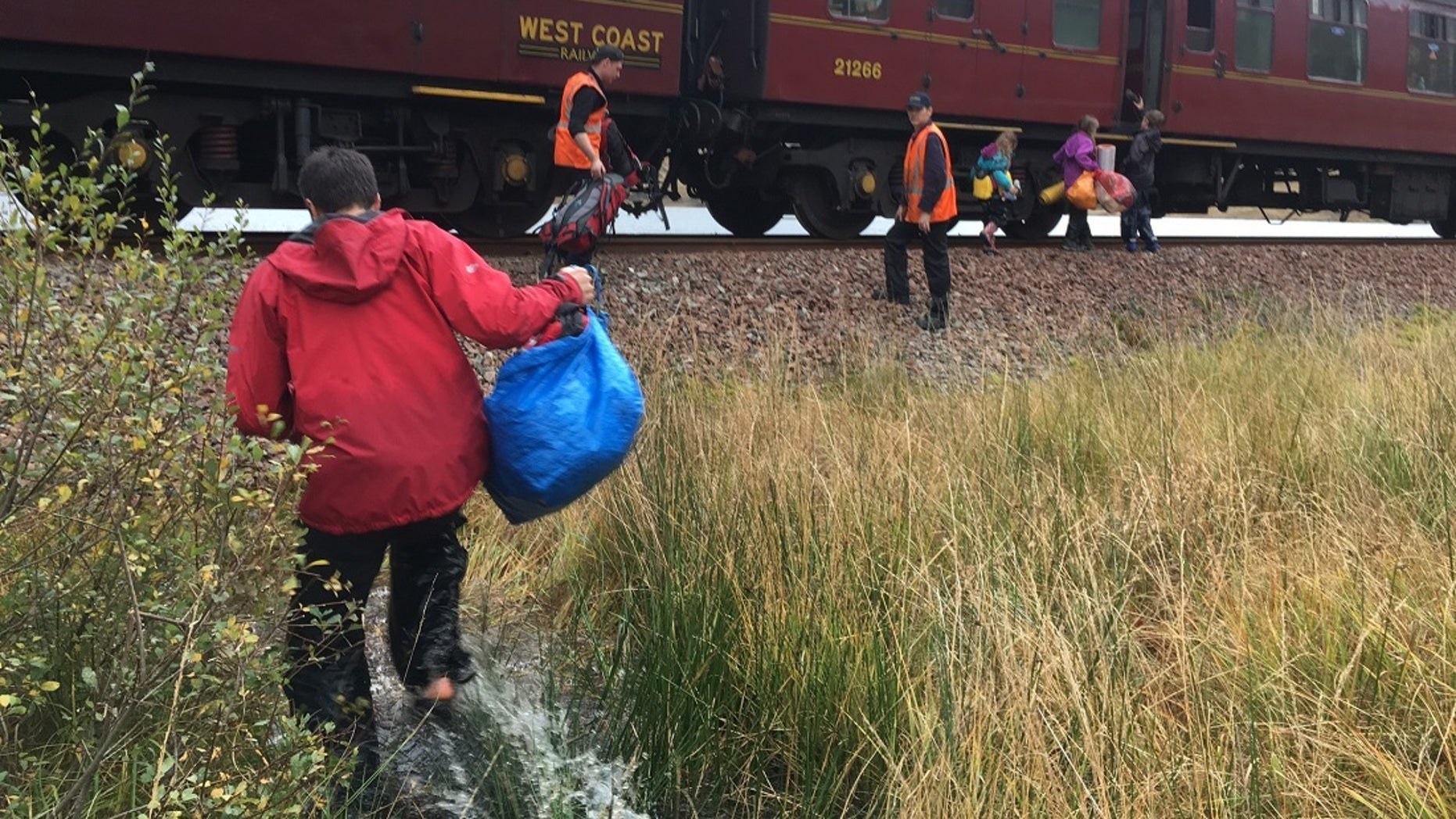 The Jacobite steam train, which played the Hogwarts Express onscreen, on Friday made an unscheduled stop to pick up a family of six that was stranded when a storm washed away their canoe.