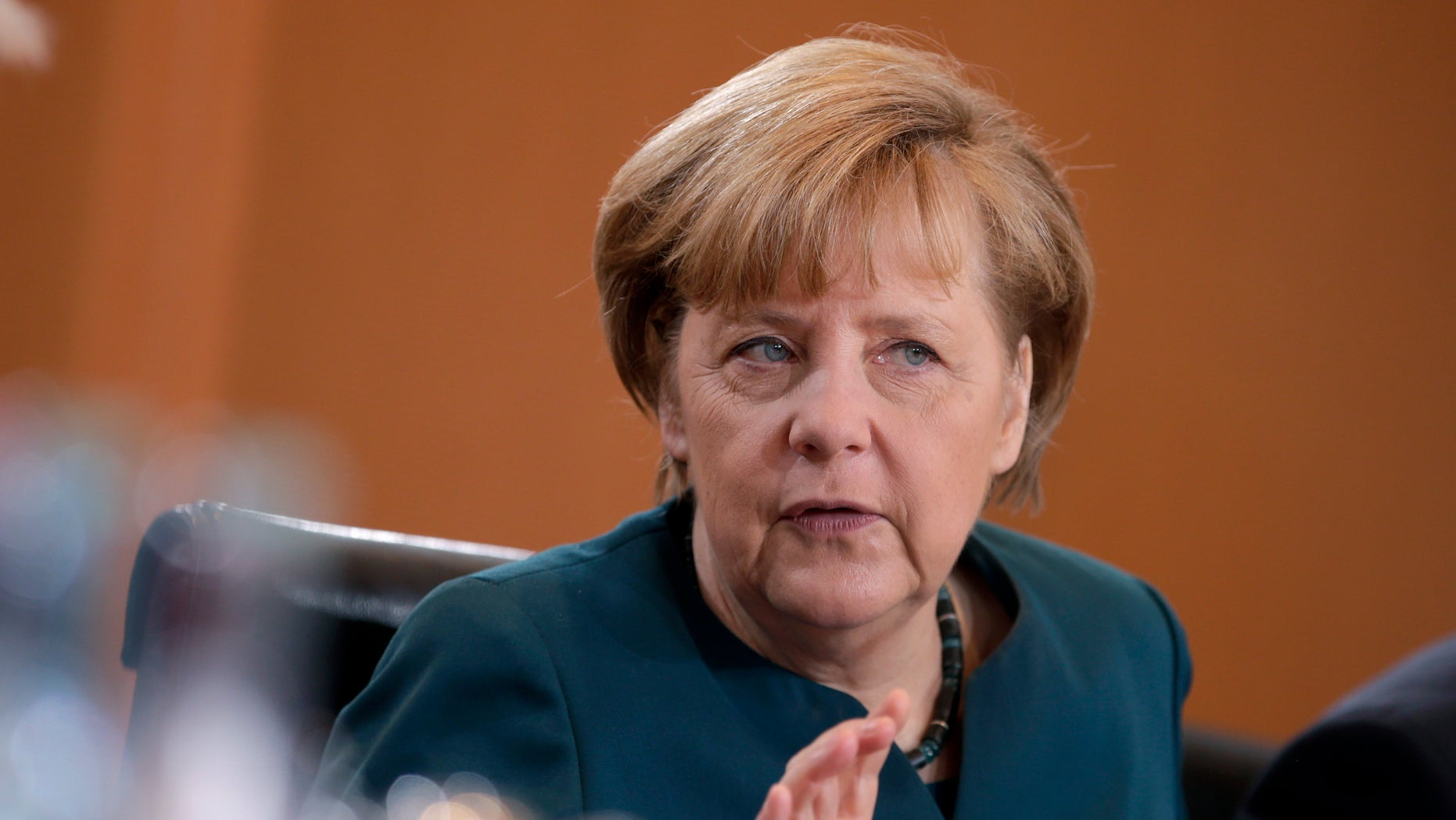 German Chancellor Angela Merkel gestures at the beginning of the weekly cabinet meeting at the chancellery in Berlin, Germany, Wednesday, Jan. 15, 2014. (AP Photo/Michael Sohn)