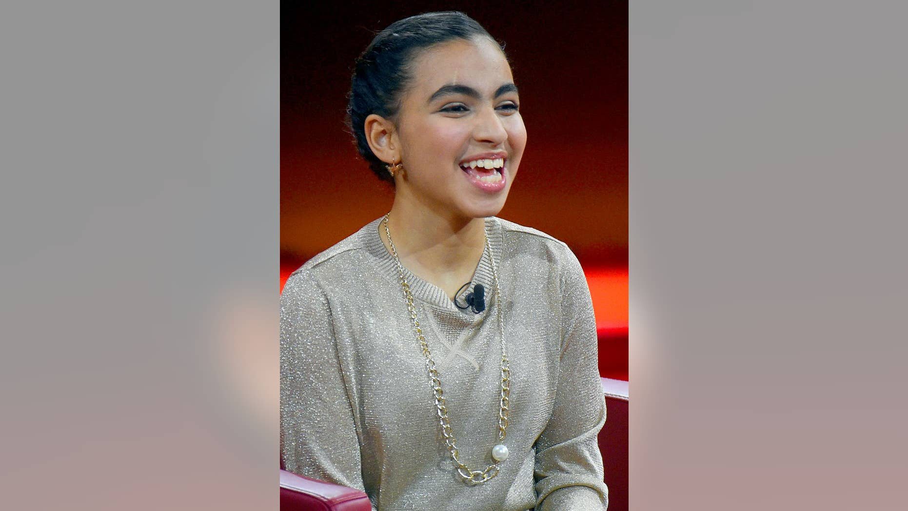 FILE - In this Dec. 6, 2015 file picture Palestinian student Reem Sahwil sits on stage during RTL's end-of-year review '2015! Menschen, Bilder, Emotionen' (lit. People, images, emotions) in Huerth, Germany. The Palestinian girl whose encounter with German Chancellor Angela Merkel made waves last year says the incident was a turning point in her life.  Reem Sawhil burst into tears during a town hall event with Merkel last July as she recounted how she feared that she or her family might be deported. Sawhil told German weekly Bild am Sonntag that she had gained confidence following the incident and recently attempted to walk unaided.  (Henning Kaiser/dpa via AP,file)