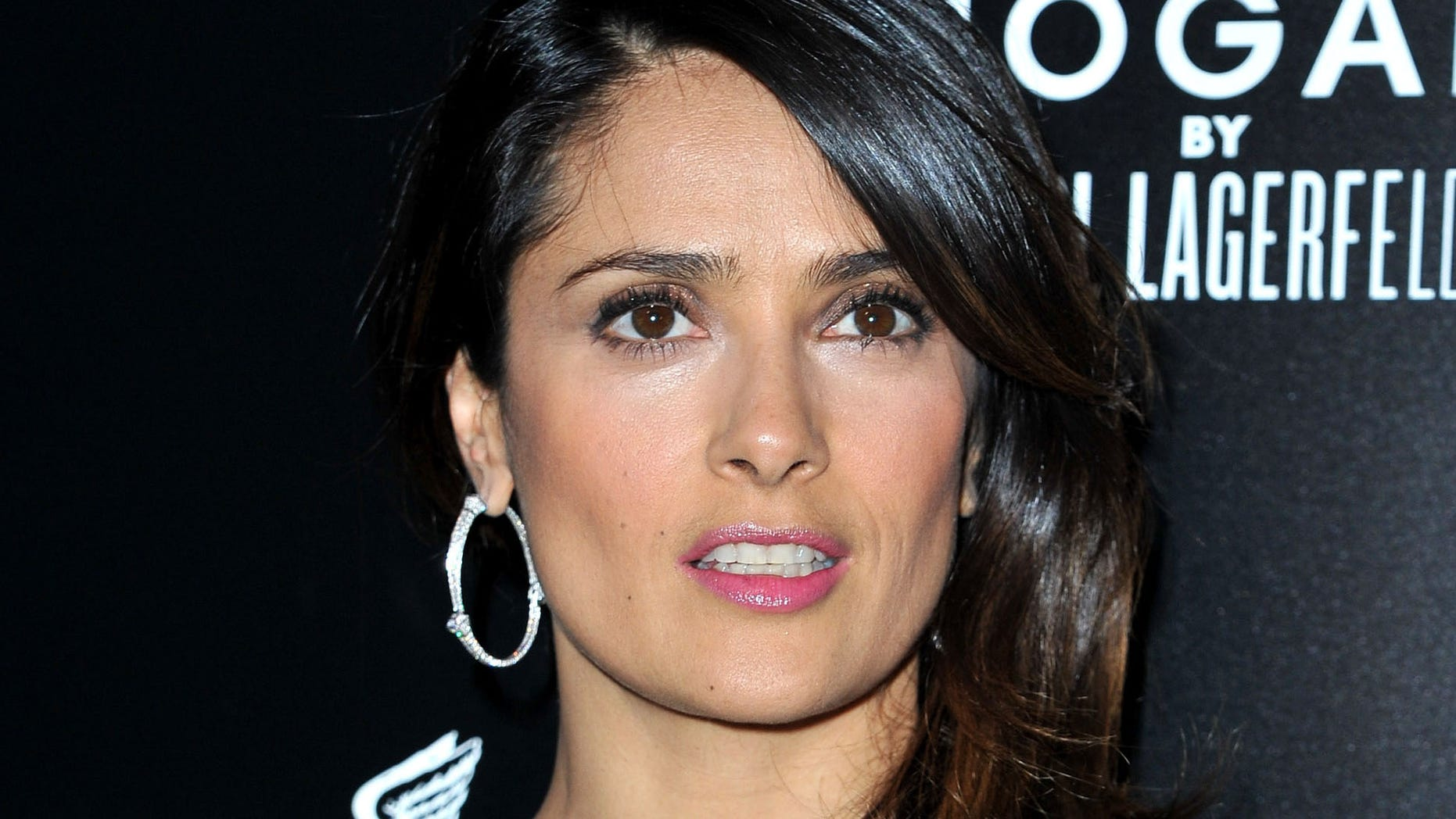 PARIS, FRANCE - MARCH 01:  Salma Hayek attends the Hogan by Karl Lagerfeld Ready-To-Wear Fall/Winter 2012 Presentation and Cocktail as part of Paris Fashion Week at Galerie Bailly on March 1, 2012 in Paris, France.  (Photo by Pascal Le Segretain/Getty Images)