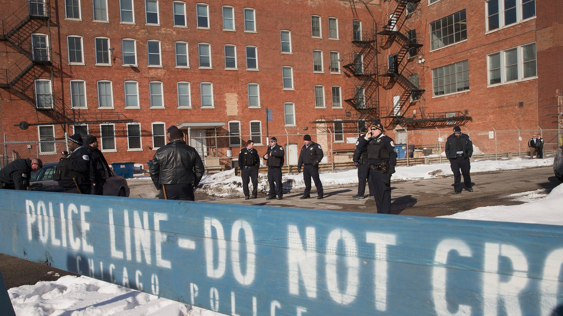 CHICAGO, IL - FEBRUARY 28: Police stand guard as demonstrators protest outside a Chicago Police facility on the city's Westside on February 28, 2015 in Chicago, Illinois. The demonstrators were demanding changes after a British newspaper article recently claimed the facility was used by Chicago police as a 'secret interrogation facility.' (Photo by Scott Olson/Getty Images)