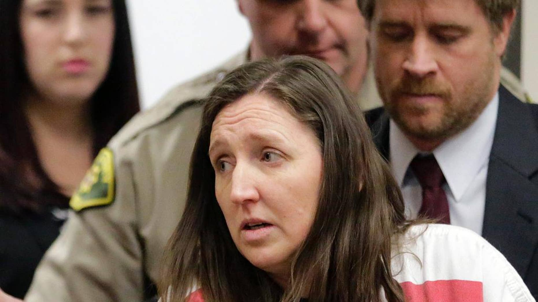 Feb. 12, 2015: In this file photo, Megan Huntsman arrives in court in Provo, Utah. Huntsman who pleaded guilty to killing six of her newborn babies and storing their bodies in her garage is set to be sentenced.