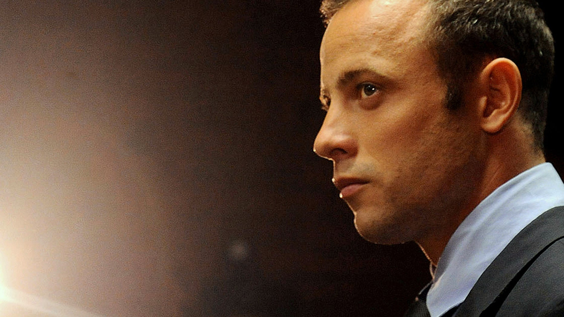 FILE - In this photo taken Friday, Feb. 26, 2013 file photo, Olympic athlete, Oscar Pistorius appears in court for his bail hearing after being charged with the shooting of his girlfriend, Reeva Steenkamp, in Pretoria, South Africa.  Oscar Pistorius and Caster Semenya have been left off a list of athletes to receive funding by the South African Olympic Committee ahead of the 2016 Rio Games. South African Sports Confederation and Olympic Committee chief executive Tubby Reddy says Pistorius wasn't included on the Operation Excellence support program because of his decision not to compete this year to concentrate on his murder trial. He's accused of shooting his girlfriend. (AP Photo/Themba Hadebe, File)