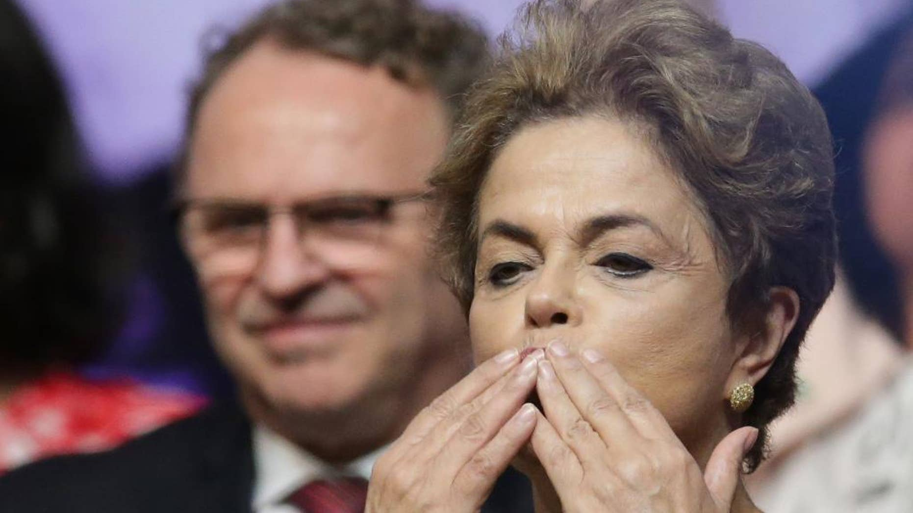 Brazil's President Dilma Rousseff blows kisses during the opening of the National Conference of Women, in Brasilia, Brazil, Tuesday, May 10, 2016. The impeachment proceedings against Rousseff took another hairpin turn Tuesday after the acting speaker of Congress' lower house Waldir Maranhao put the impeachment process back on track a day after he sparked chaos and sowed further discord among Brazil's fractious political class by annulling an April 17 vote by the Chamber of Deputies for impeachment. (AP Photo/Eraldo Peres)