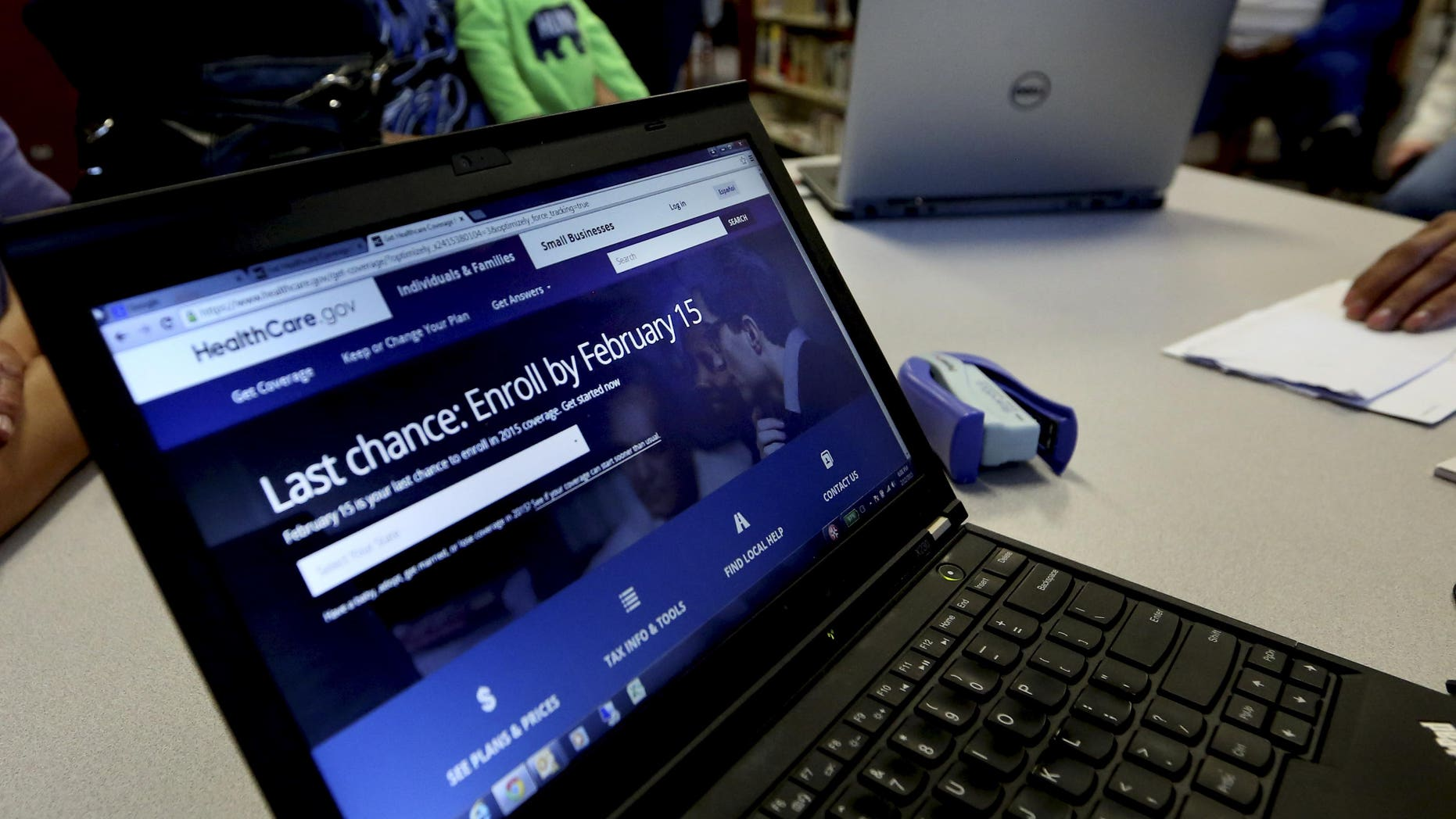 In this Thursday, Feb. 12, 2015 photo, a laptop shows the HealthCare.com web site during an Affordable Care Act enrollment event at the Fort Worth Public Library in Fort Worth, Texas. For the second year in a row, millions of Americans have signed up for subsidized health insurance under President Barack Obama's law. But as the 2015 sign-up season draws to a close Sunday, the future of the Affordable Care Act remains in doubt.  (AP Photo/LM Otero)