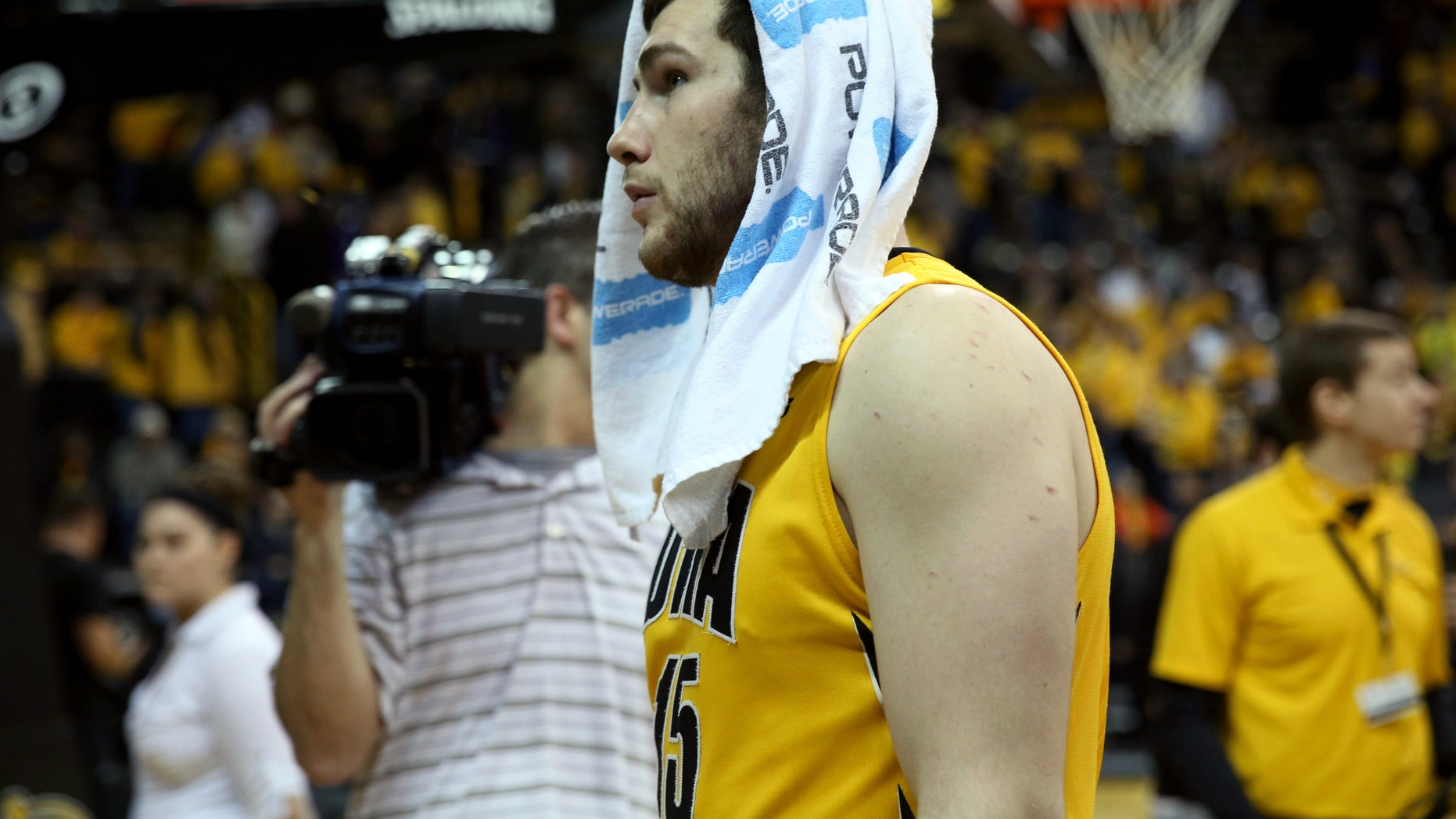 Iowa forward Zach McCabe walks off the floor after their 79-74 loss to Wisconsin during an NCAA college basketball game in Iowa City, Iowa, Saturday, Feb. 22, 2014. Wisconsin won 79-74. (AP Photo/Justin Hayworth)