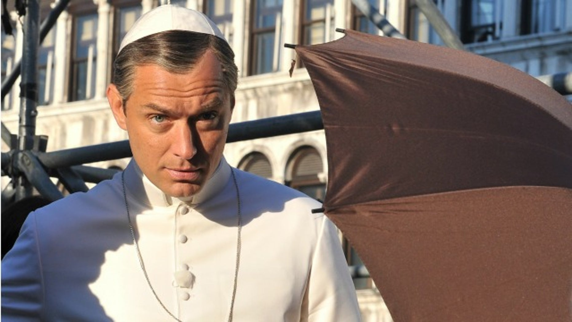 """Actor Jude Law is seen on the set of Italian director Paolo Sorrentino's TV series """"The Young Pope"""", in Venice's St. Mark's Square, Italy, Tuesday, Jan. 12, 2016. Law plays the part of a fictional Pope Pius XIII as the first American pope. (AP Photo/Luigi Costantini)"""
