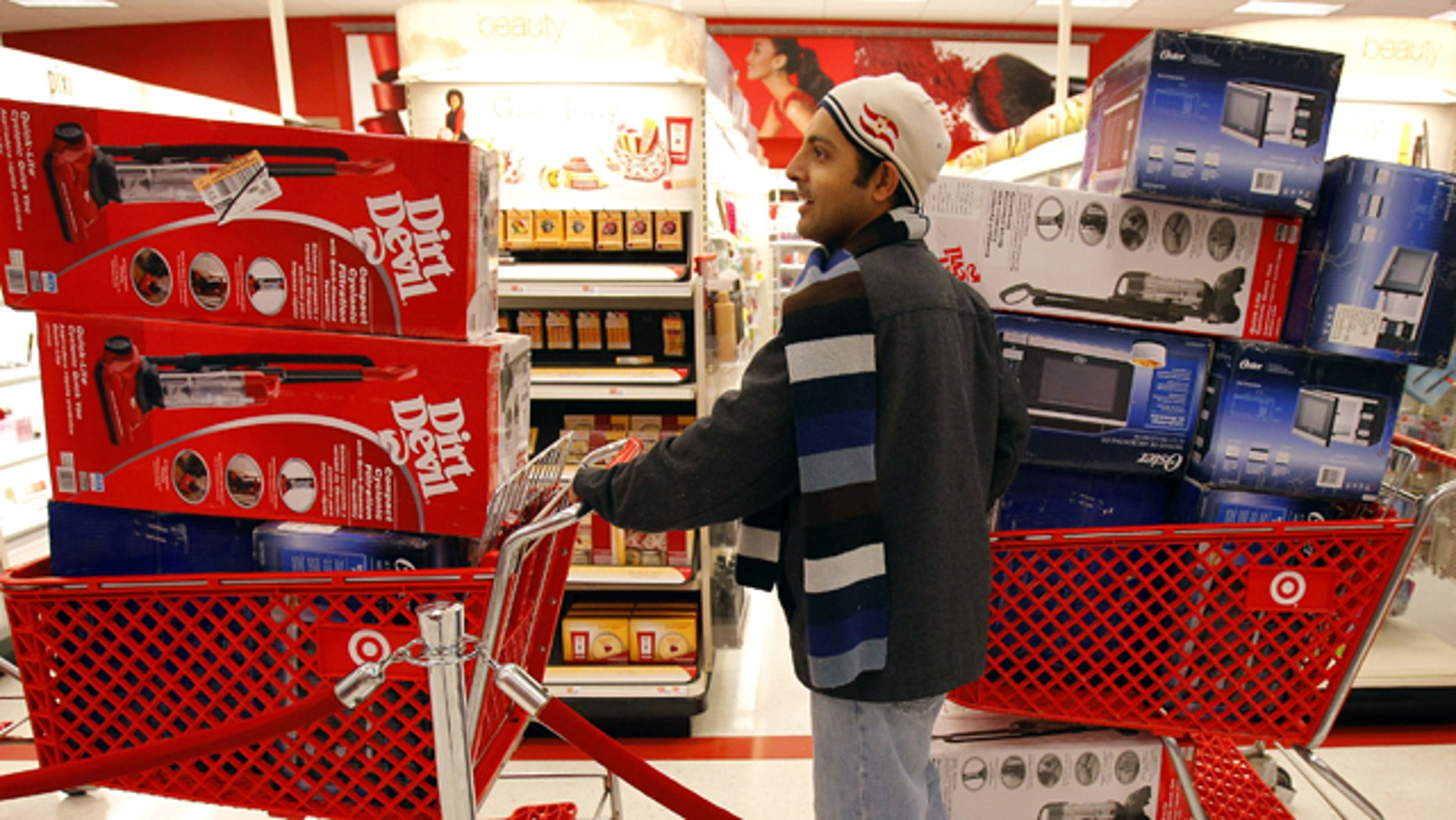 Nov. 26: A man waits in line to check out at a Target store on Black Friday in Lanesborough, Mass.