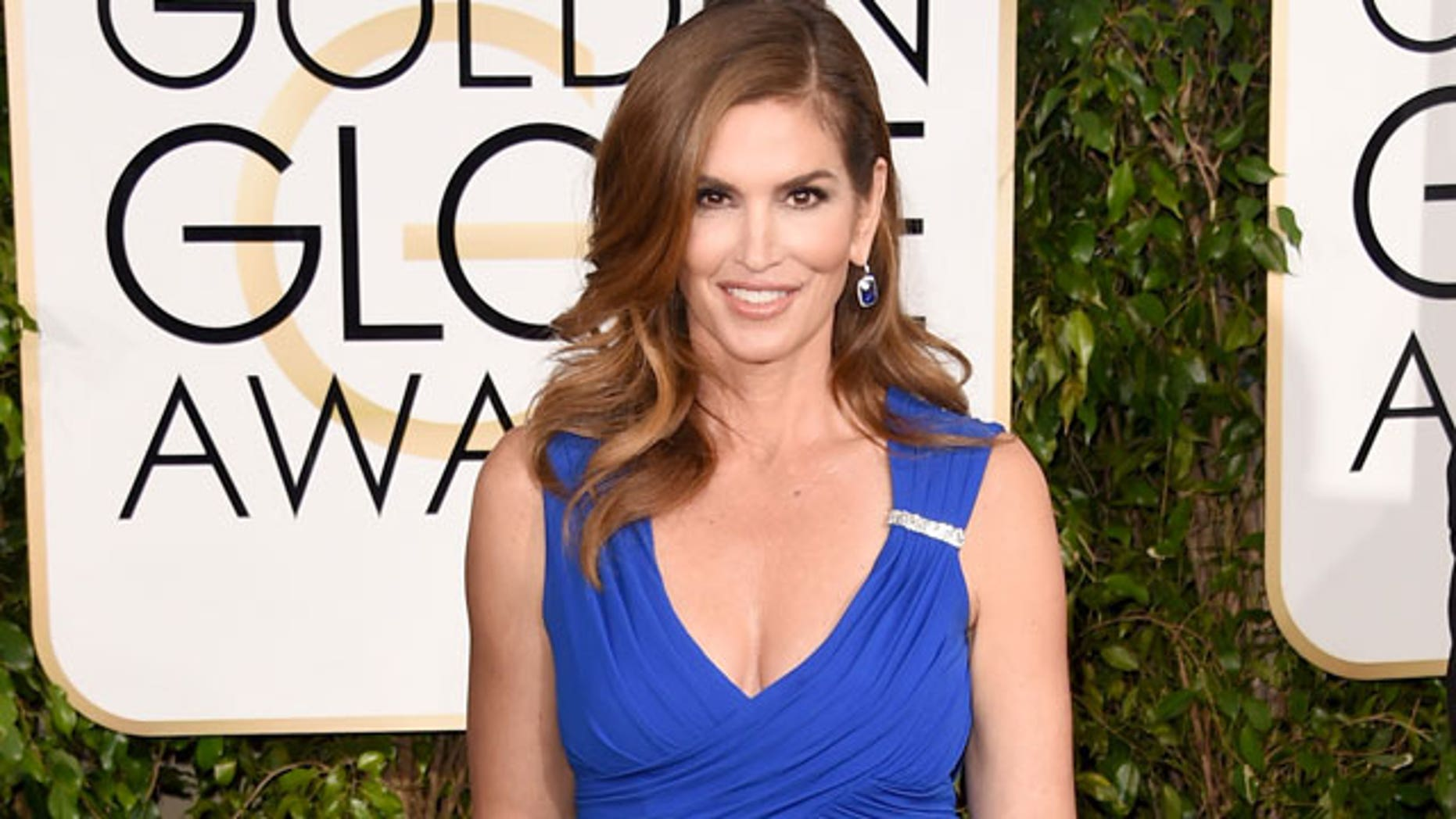 Veteran supermodel Cindy Crawford explains why she still poses nude at 53.