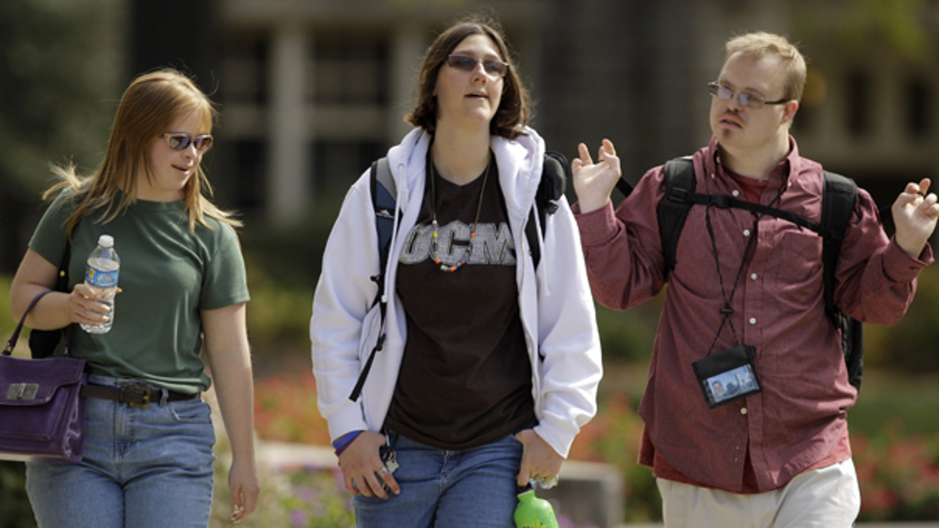 Oct. 13: Gabe Savage, right, Alex Schaffer, center, and Mallory Graves, walk across campus at Central Missouri State University in Warrensburg, Mo.
