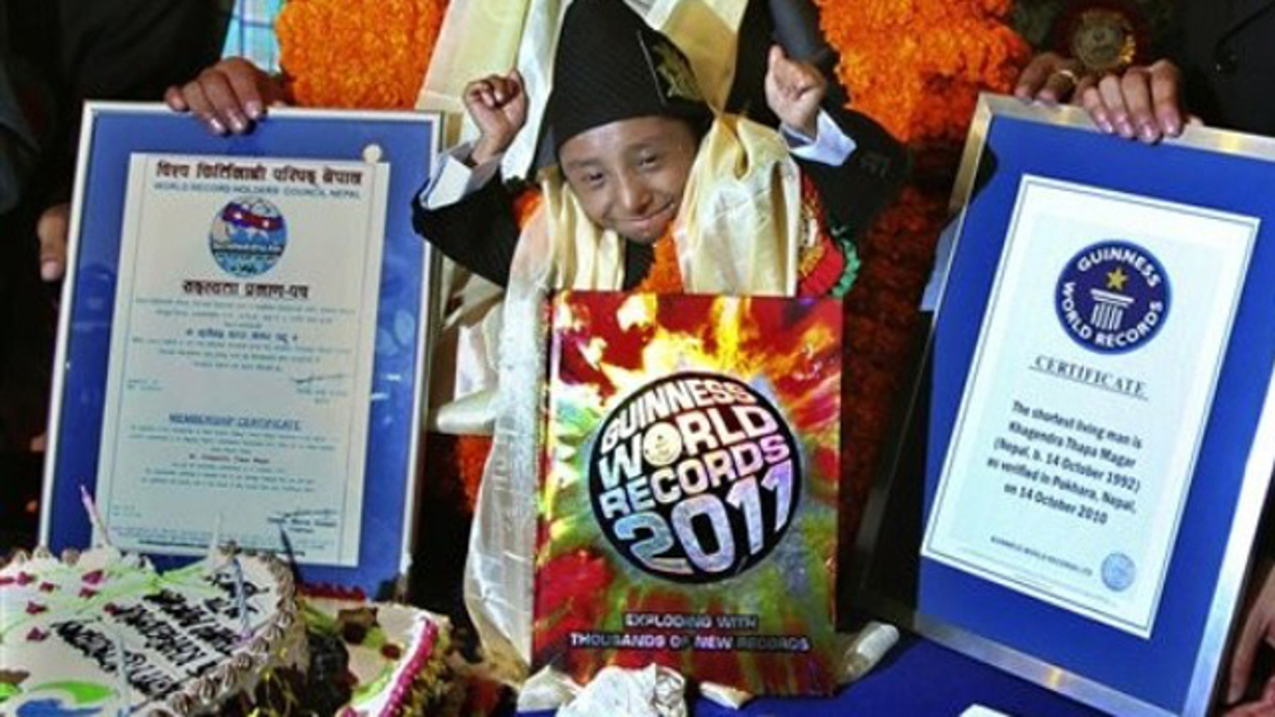 Oct. 14: Nepal's Khagendra Thapa Magar celebrates after being awarded the title of the world's shortest man by Guinness record officials, in Pokhara, 124 miles west of Katmandu, Nepal.