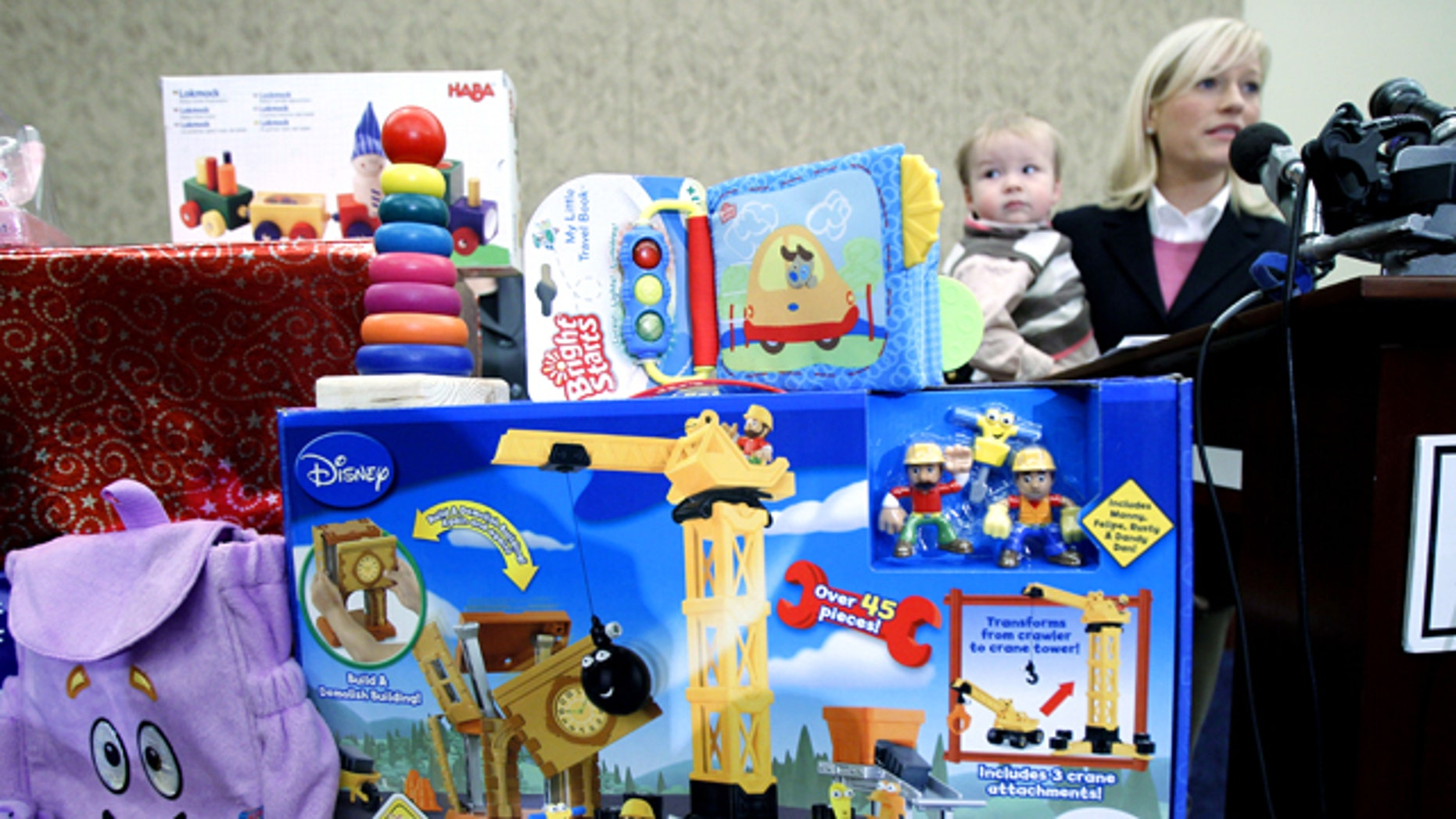 Nov. 23: Jennifer Tapper describe the problem she went through when her son 13-month-old on Jack Tapper chocked on a small part of a toy during the 25th Annual Survey of Toy Safety in Washington.
