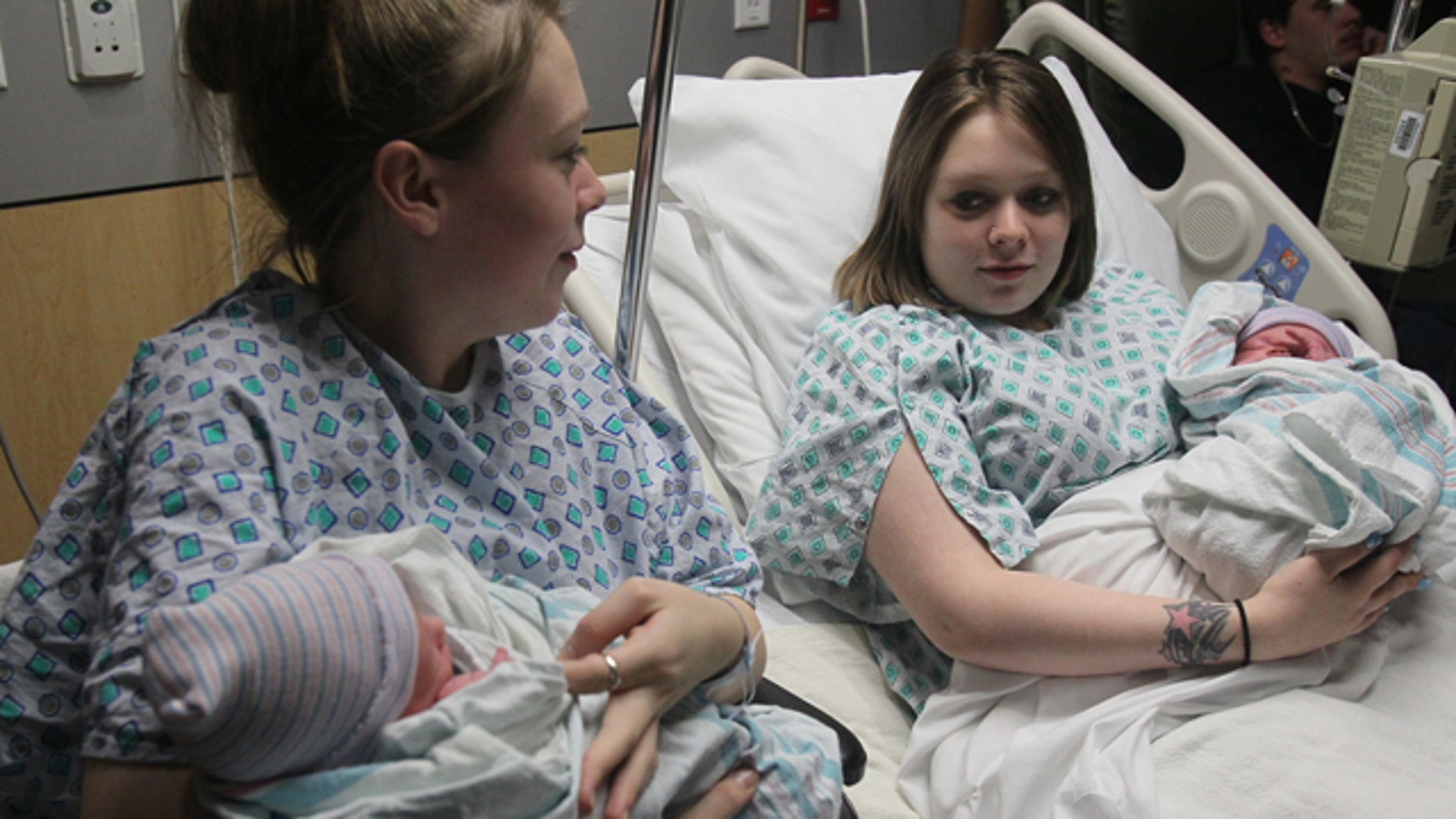 Dec. 31, 2012: Twin mothers Aimee, left, and Ashlee Nelson hold their newborn sons Donavyn Bratten, left, and Aiden Lee Alan Dilts at Summa Akron City Hospital.