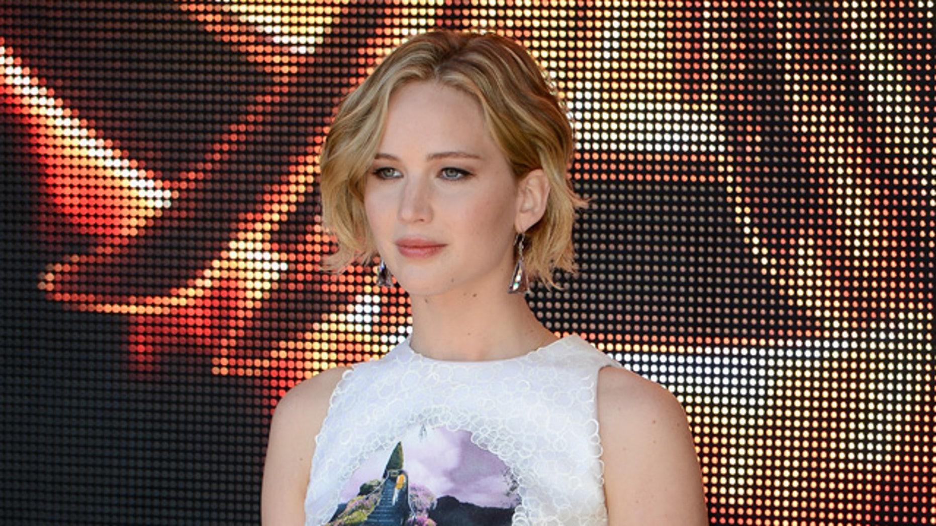 """CANNES, FRANCE - MAY 17:  Actress Jennifer Lawrence attends """"The Hunger Games: Mockingjay Part 1"""" photocall at the 67th Annual Cannes Film Festival on May 17, 2014 in Cannes, France.  (Photo by Ian Gavan/Getty Images)"""