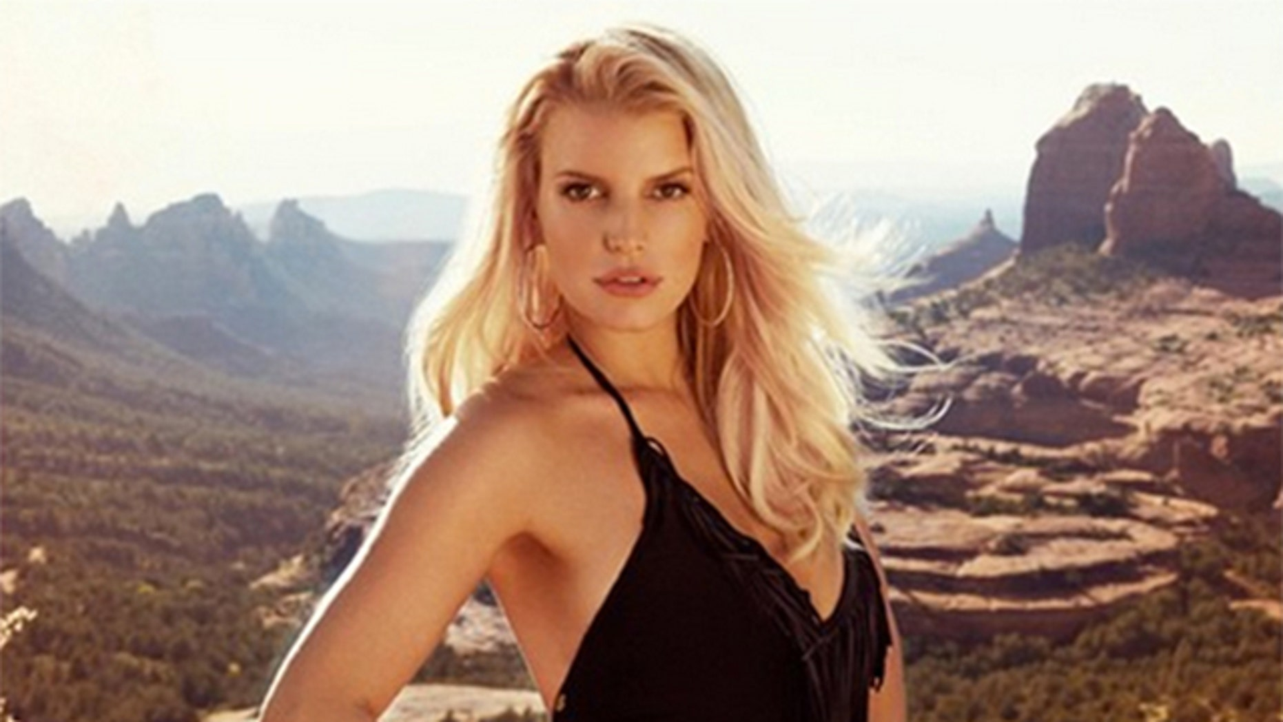 Jessica Simpson in swimsuit from her fashion line.