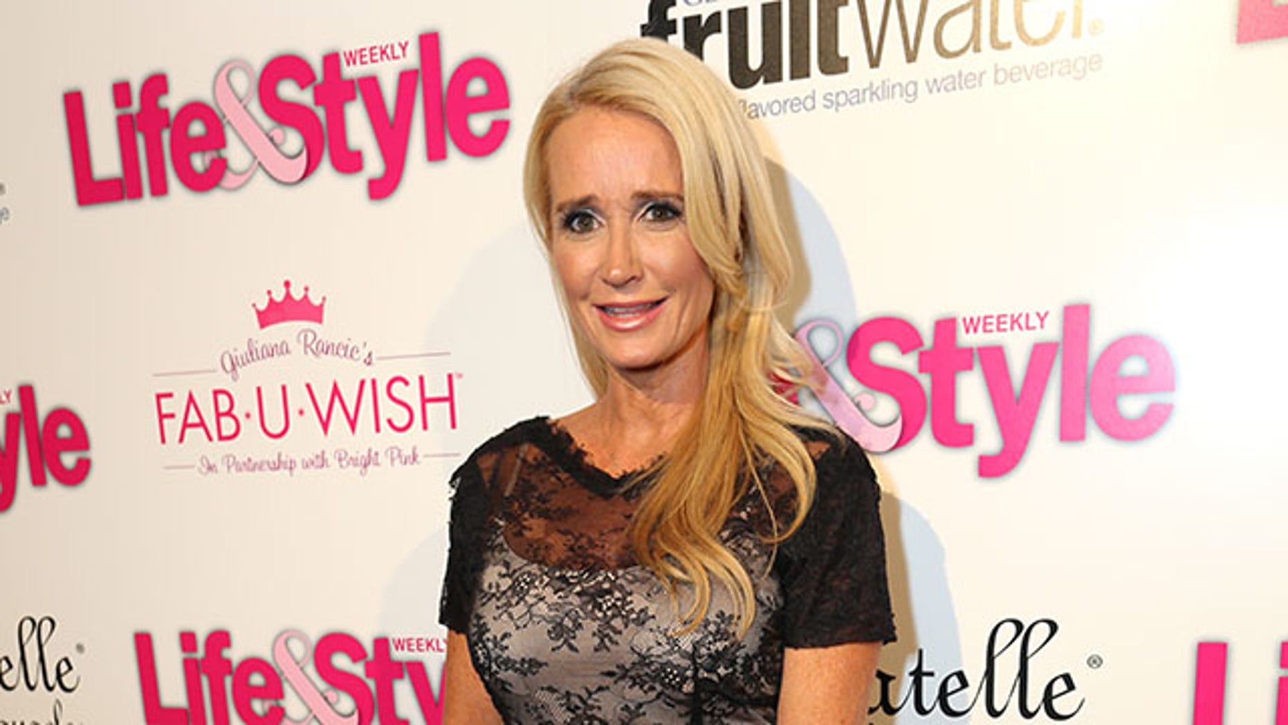 LOS ANGELES, CA - OCTOBER 09:  TV personality Kim Richards attends Hollywood in Bright Pink presented by Life & Style, hosted by Giuliana Rancic at Bagatelle on October 9, 2013 in Los Angeles, California.  (Photo by Rachel Murray/Getty Images for Life & Style)