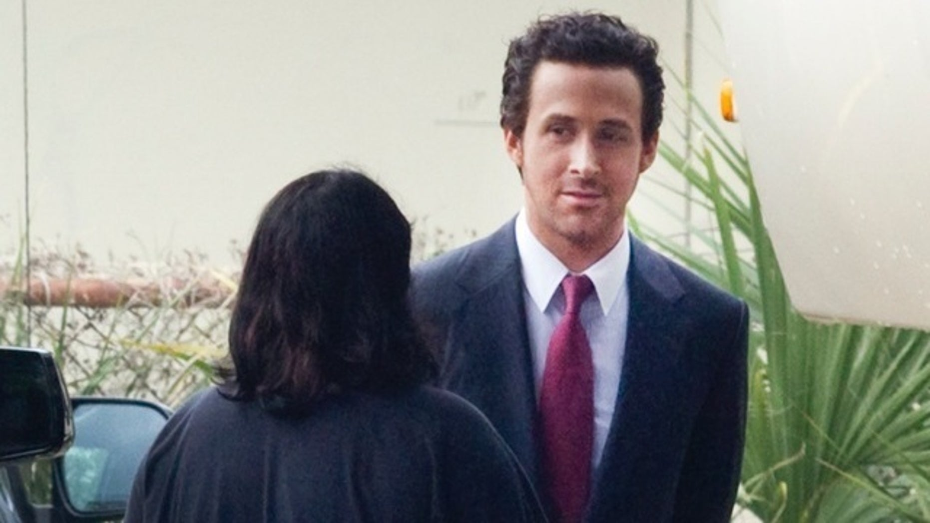 EXCLUSIVE: Ryan Gosling is a dark haired city slicker on set in New Orleans. The actor transformed into a tanned, slick dark haired businessman as he worked on his latest movie The Big Short in New Orleans, which co-stars Brad Pitt, Christian Bale and Steve Carell.