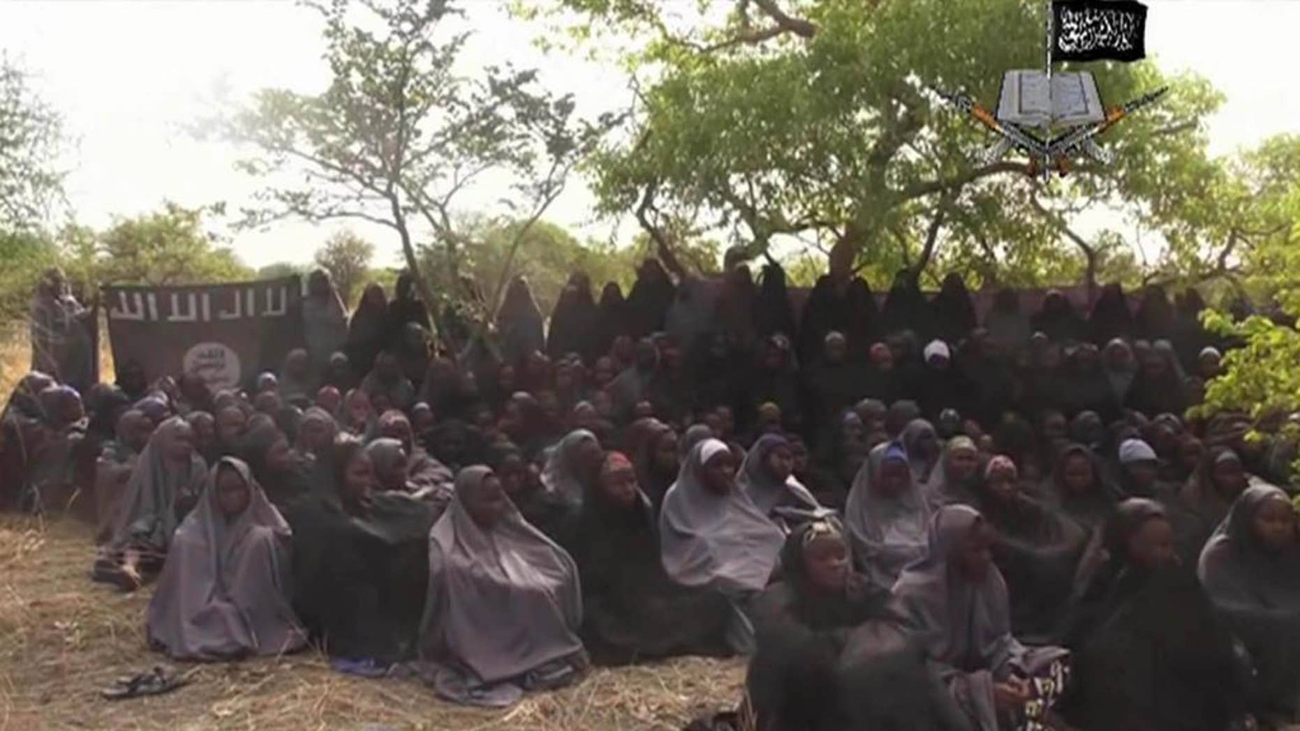FILE - This Monday May 12, 2014 file image taken from video by Nigeria's Boko Haram terrorist network, shows the alleged missing girls abducted from the northeastern town of Chibok. Nigeria's government and Islamic extremists from Boko Haram have agreed to an immediate cease-fire, officials said Friday Oct. 17, 2014. The fate of more than 200 missing schoolgirls abducted by the insurgents six months ago remains unclear. Defense Ministry spokesman Maj. Gen. Chris Olukolade said their release is still being negotiated. (AP Photo/File)