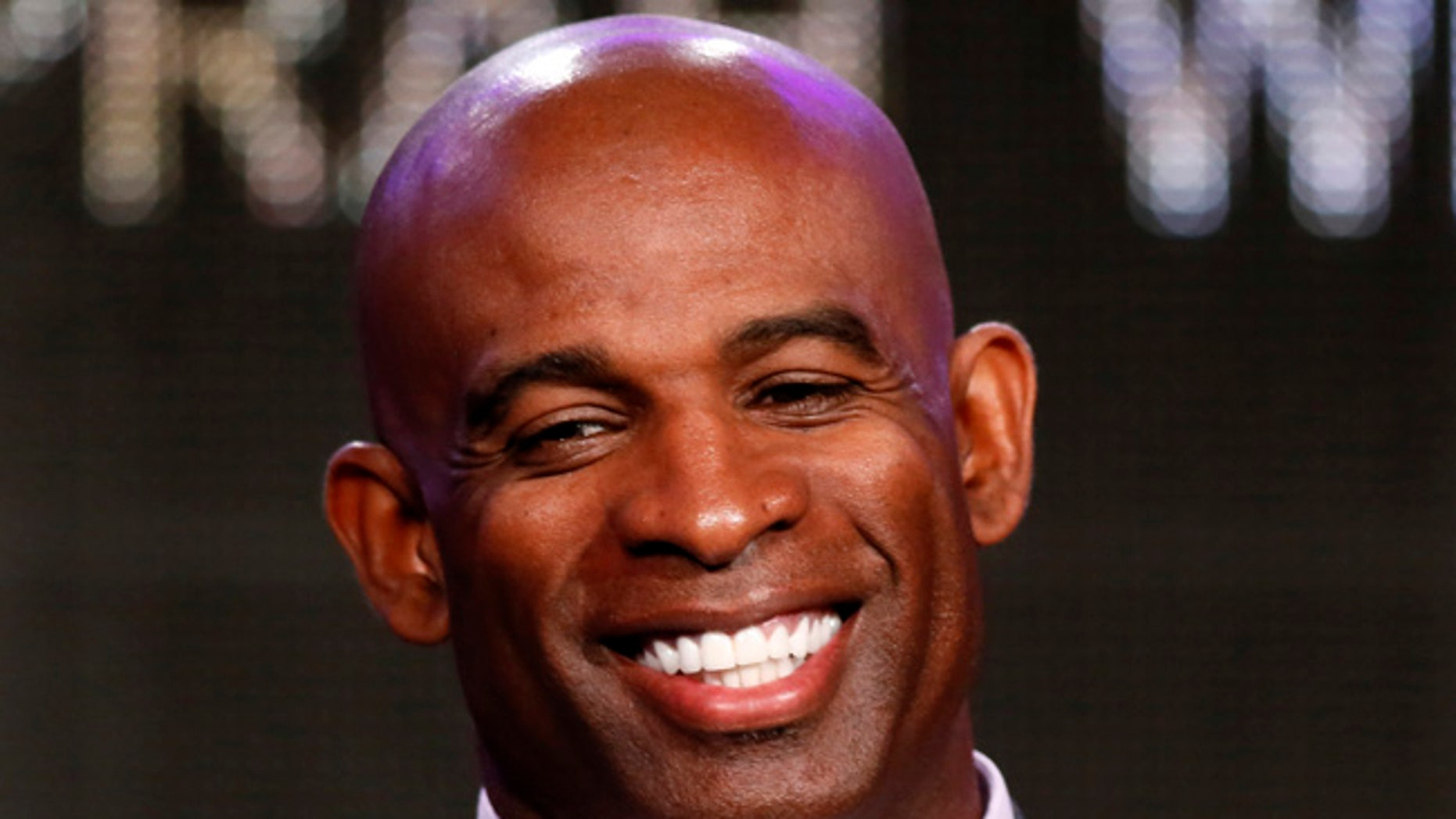 """Deion Sanders talks about OWN: Oprah Winfrey Network's """"Deion's Family Playbook"""" during the Winter 2014 TCA presentations in Pasadena, California, January 9, 2014. REUTERS/Lucy Nicholson (UNITED STATES - Tags: ENTERTAINMENT PROFILE HEADSHOT SPORT FOOTBALL) - RTX177SQ"""