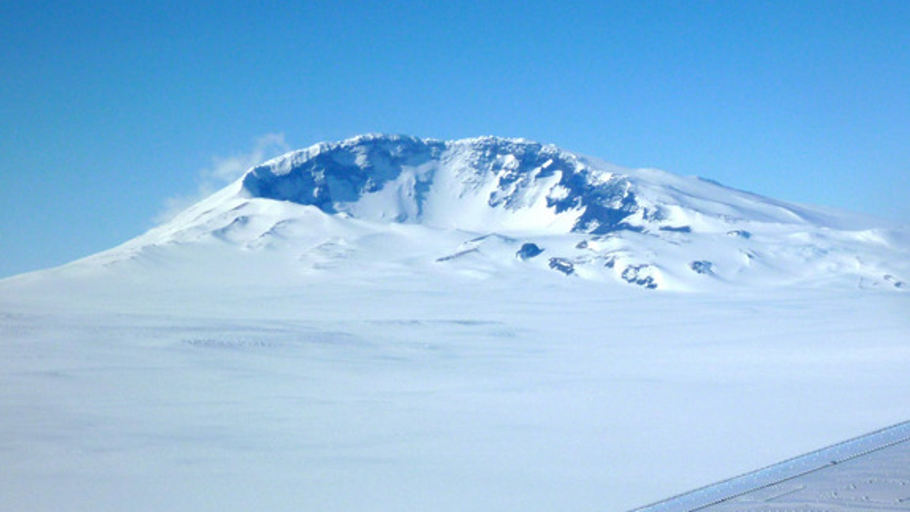 Mount Sidley is the youngest volcano rising above the ice in West Antarctica's Executive Committee Range. A group of seismologists has detected new volcanic activity under the ice about 30 miles ahead of Mount Sidley.