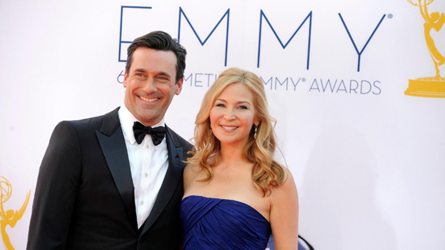 Sept. 23, 2012: Jon Hamm, left and Jennifer Westfeldt arrive at the 64th Primetime Emmy Awards at the Nokia Theatre in Los Angeles.