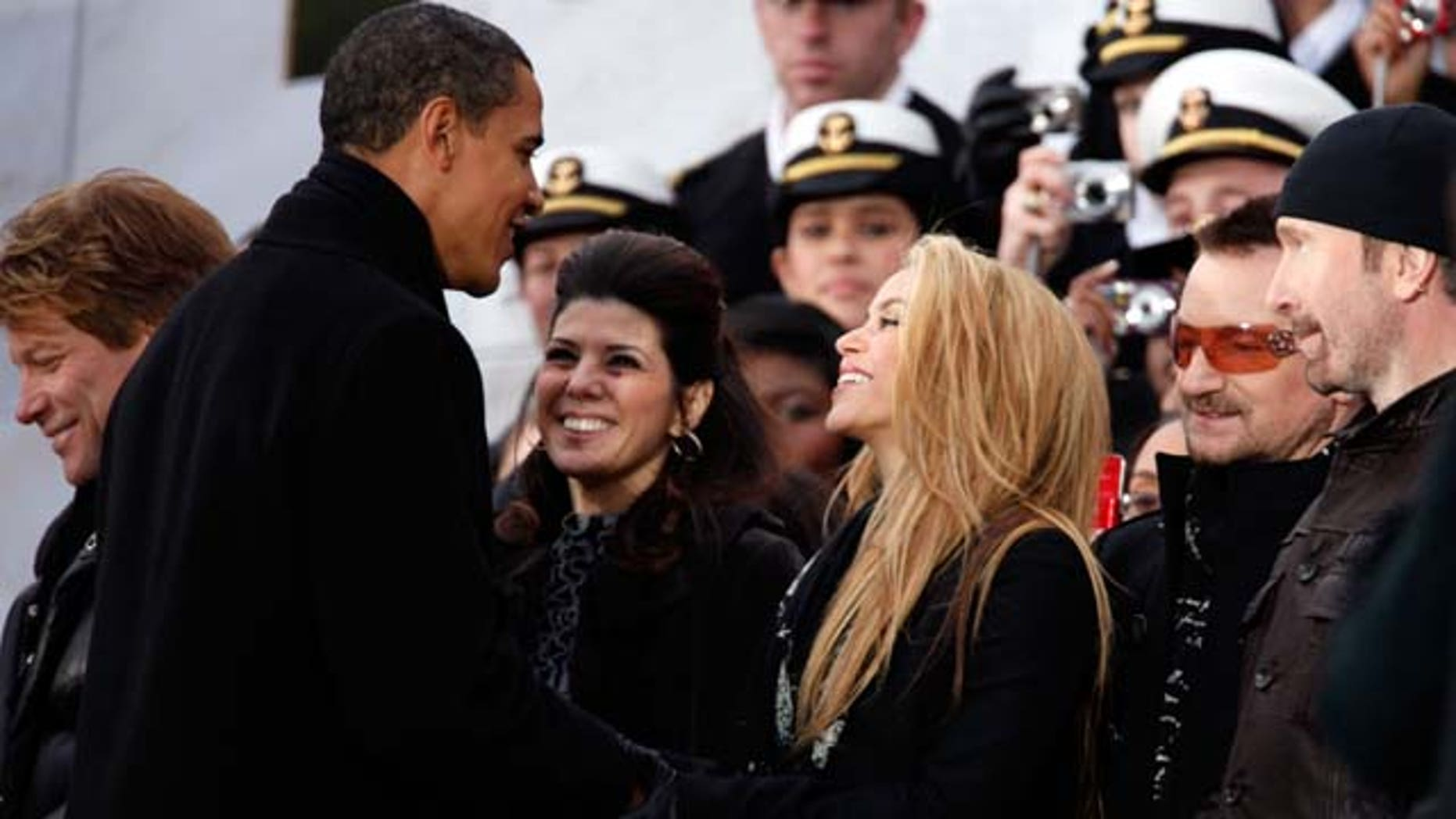 January 18, 2009: U.S. President-elect Barack Obama shakes hands with Shakira and Marisa Tomei, Bono and the Edge in front of the Lincoln Memorial during the 'We Are One: The Obama Inaugural Celebration At The Lincoln Memorial' at the National Mall in Washington, DC. The event includes a diverse array of talent featuring both musical performances and historical readings and an appearance by U.S. President-elect Barack Obama.