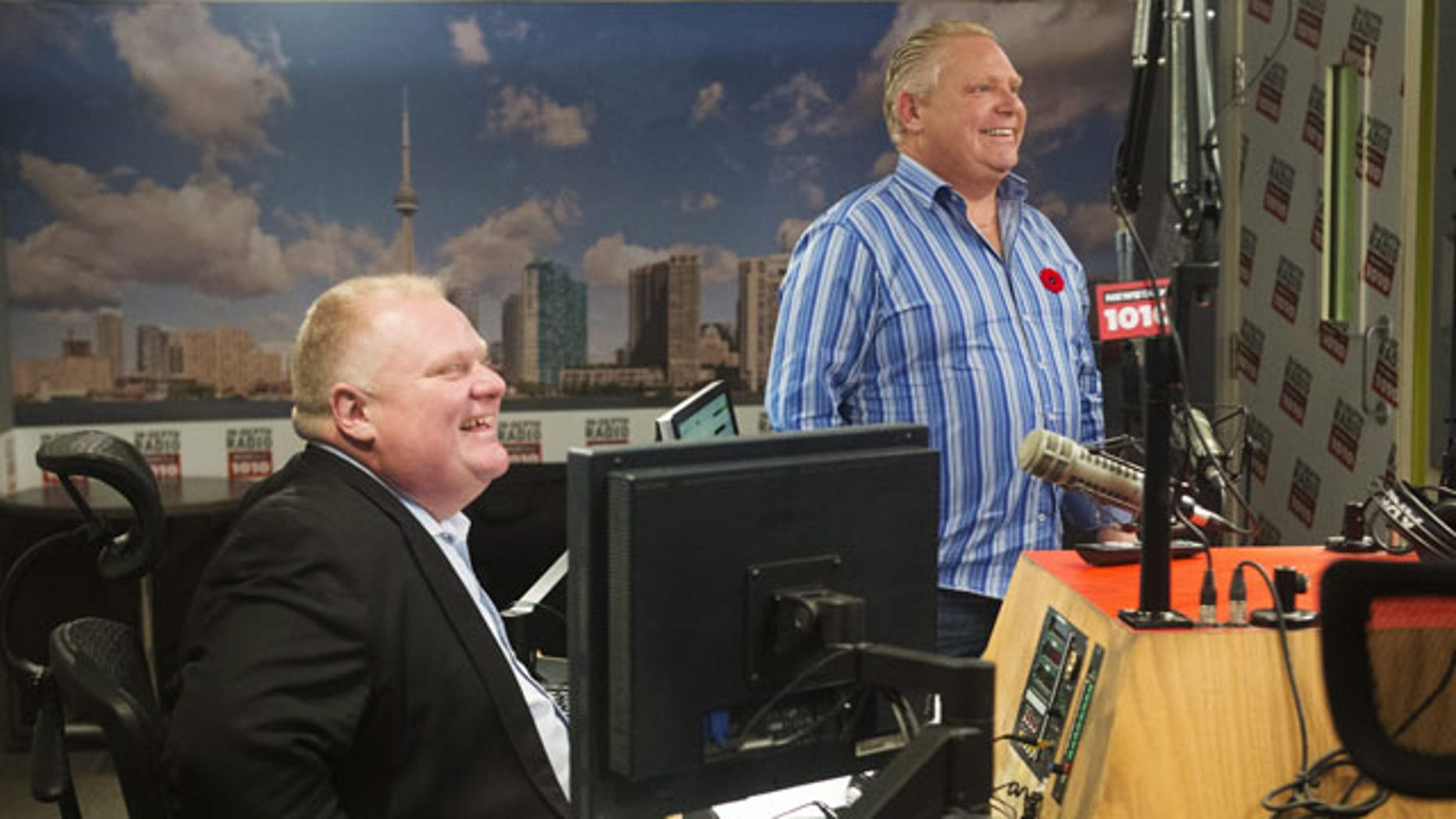 November 3, 2013: Toronto Mayor Rob Ford and his brother, Toronto city councillor Doug Ford, right, appear on a radio show in Toronto. (AP Photo/The Canadian Press, Mark Blinch)