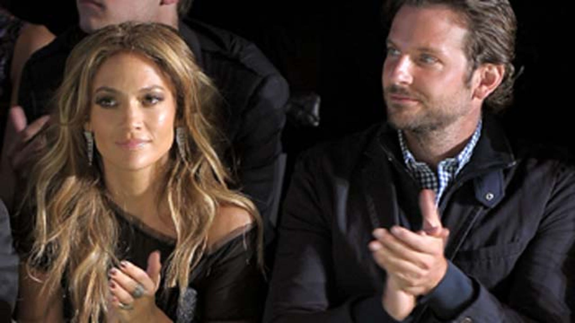 Sept. 12, 2010: Singer/actress Jennifer Lopez and actor Bradley Cooper attend the Tommy Hilfiger Spring 2011 fashion show during Mercedes-Benz Fashion Week at The Theater at Lincoln Center  in New York City.