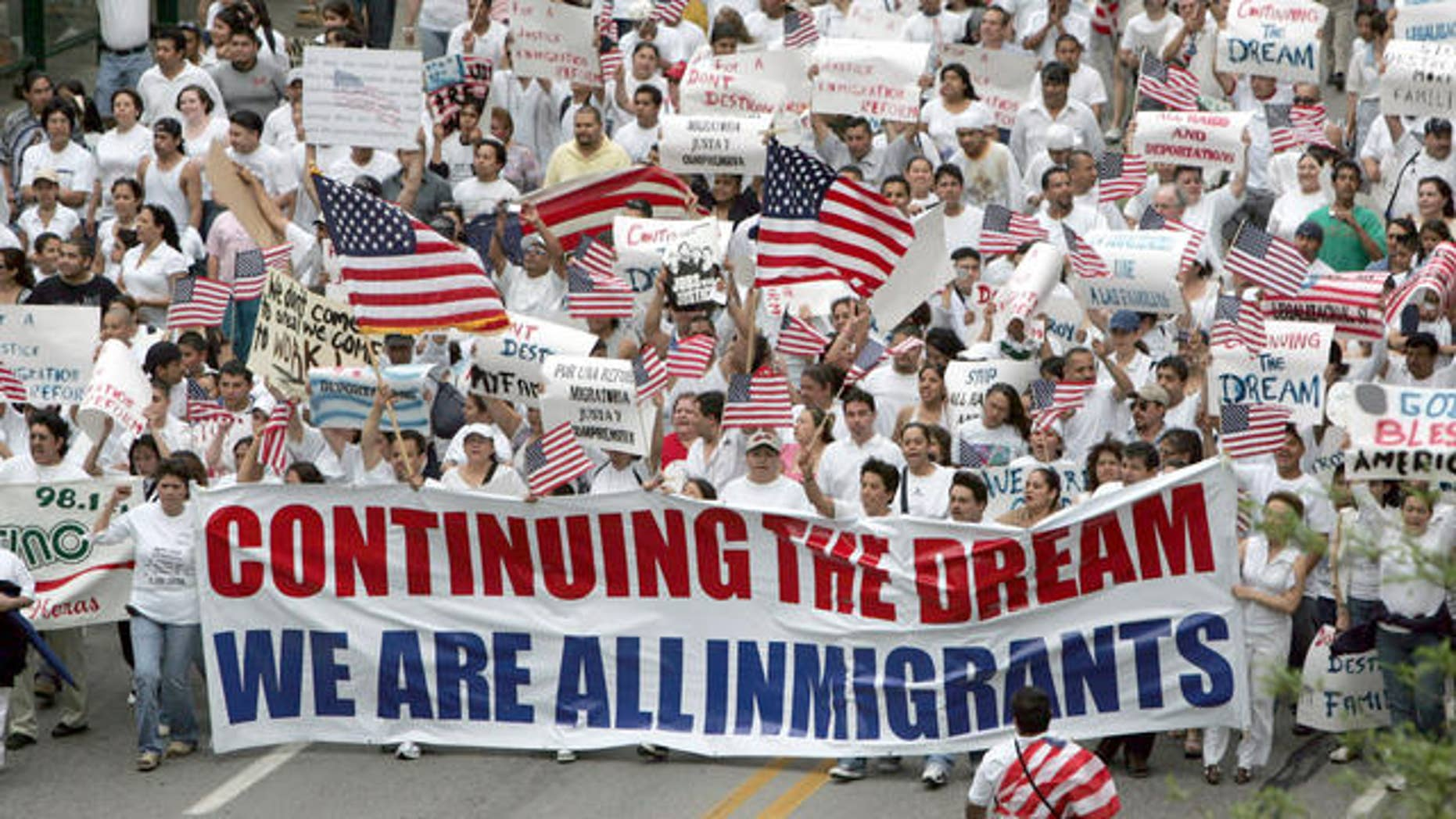 Marchers in support of immigration reform walk the streets of Indianapolis, Tuesday, May 1, 2007. Marches and rallies took place in dozens of cities across the United States. (AP Photo/AJ Mast)