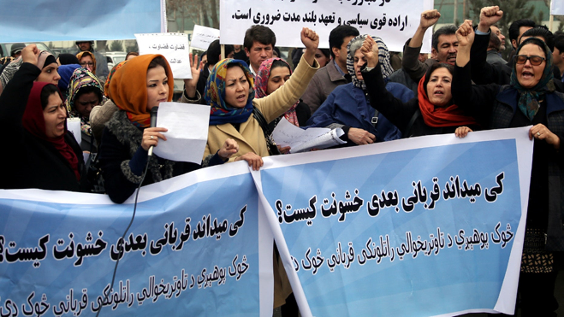 """Feb. 23, 2015: Afghanistan civil society activists participate in a demonstration to protest the increasing violence against women in their country, in front of the High Court in Kabul, Afghanistan. Writing on the posters reads: """"Who knows who will be the next victim of violence?,"""" """"We want the rapists to receive punishment,"""" and """"to fight against violence we need a strong decision."""""""