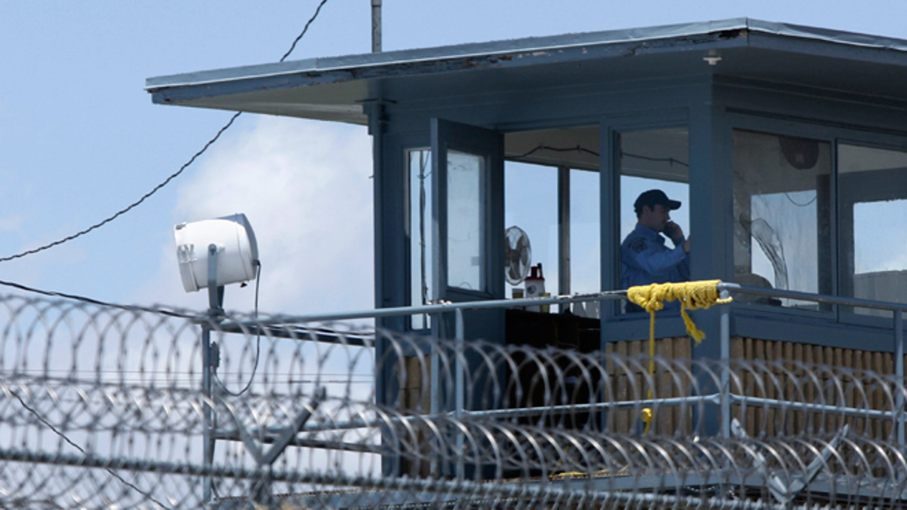 FILE - May 13, 2011: A guard sits in a tower at the Arkansas Department of Correction Tucker Unit near Tucker, Ark. Arkansas Gov. Asa Hutchinson on  Feb. 18, 2015, detailed his effort to to reduce the backlog of more than 2,600 state inmates in county jails throughout Arkansas.