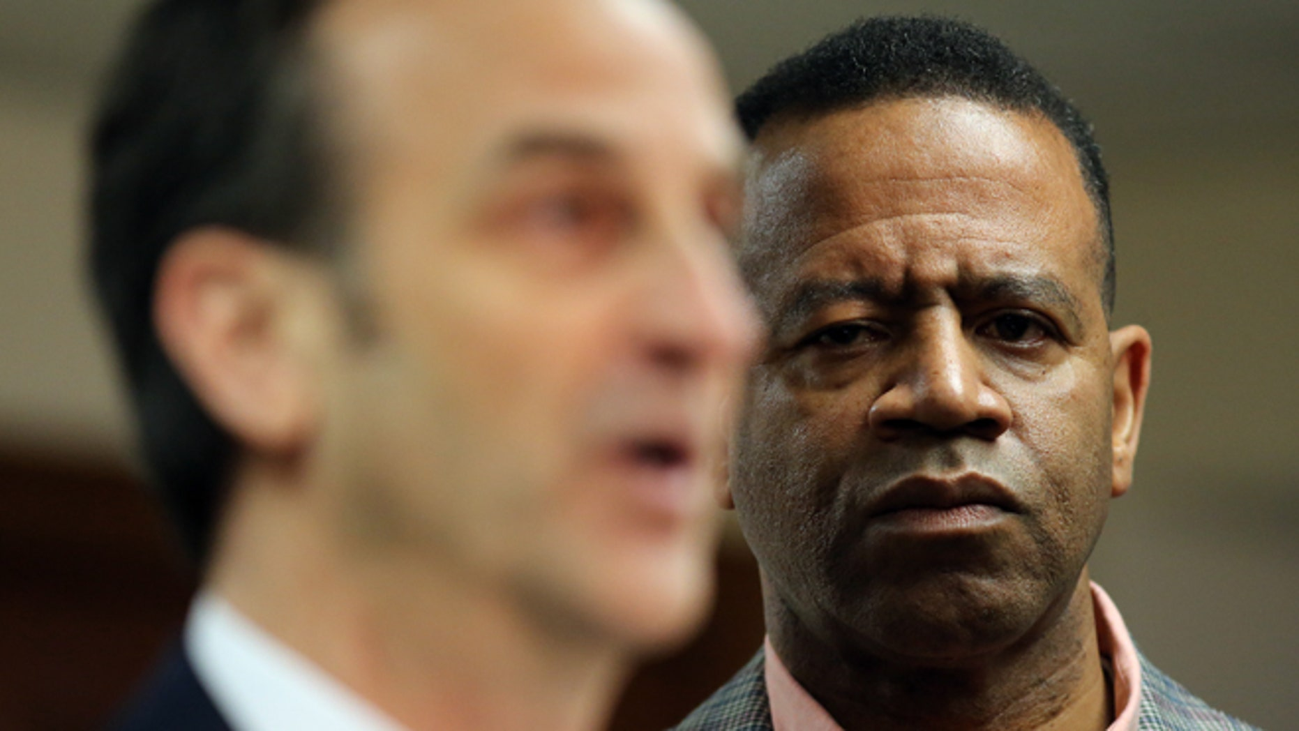 Feb. 18, 2015: Kelvin Cochran, right,who was fired from his position as Atlanta Fire Chief, listens as his attorney David Cortman answers questions at a press conference where he and his attorney announced that they had filed a federal lawsuit against the City of Atlanta.