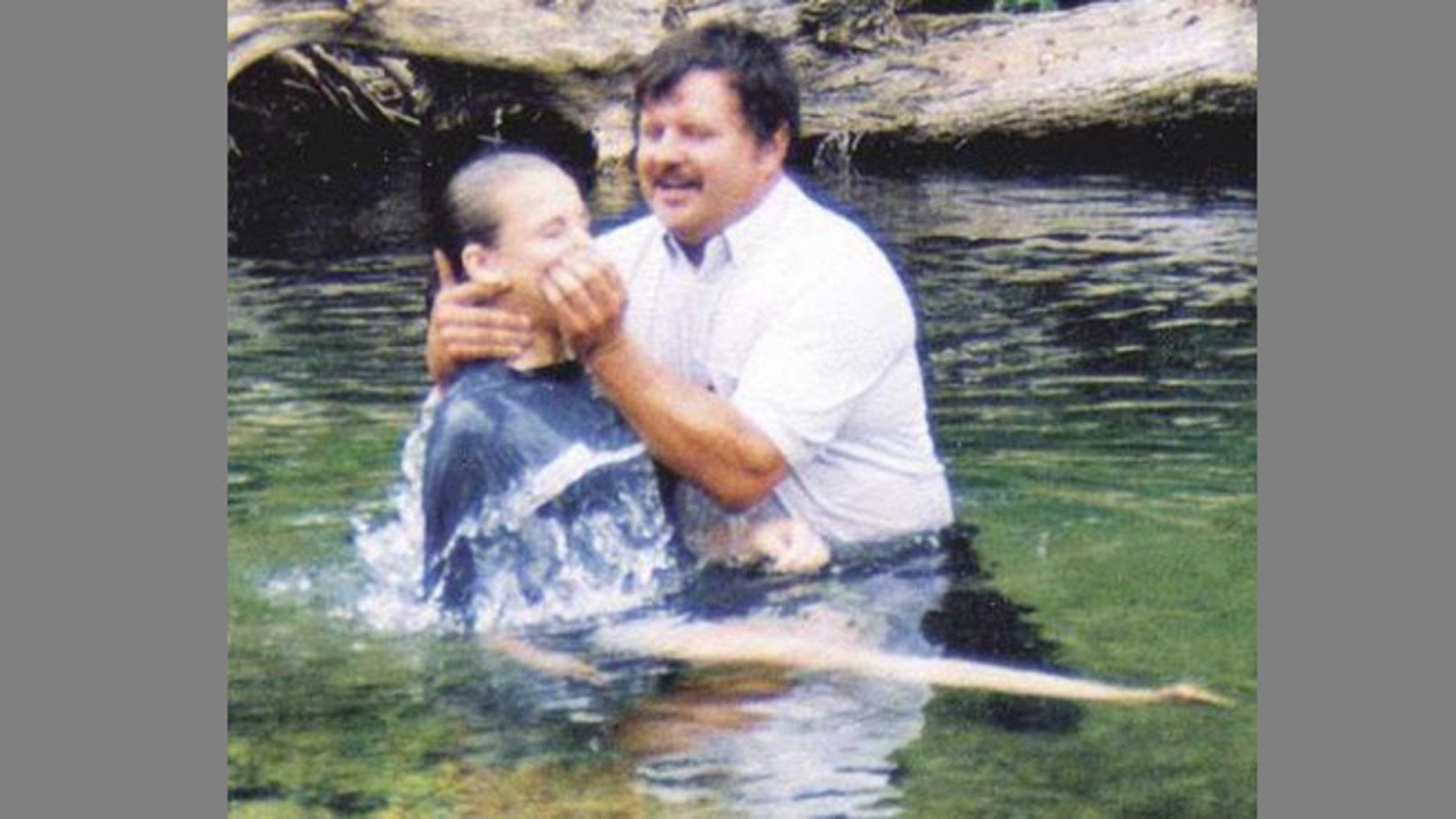 Pastor Jim Privett of Gladden Baptist Church performs a baptism in a Missouri creek.