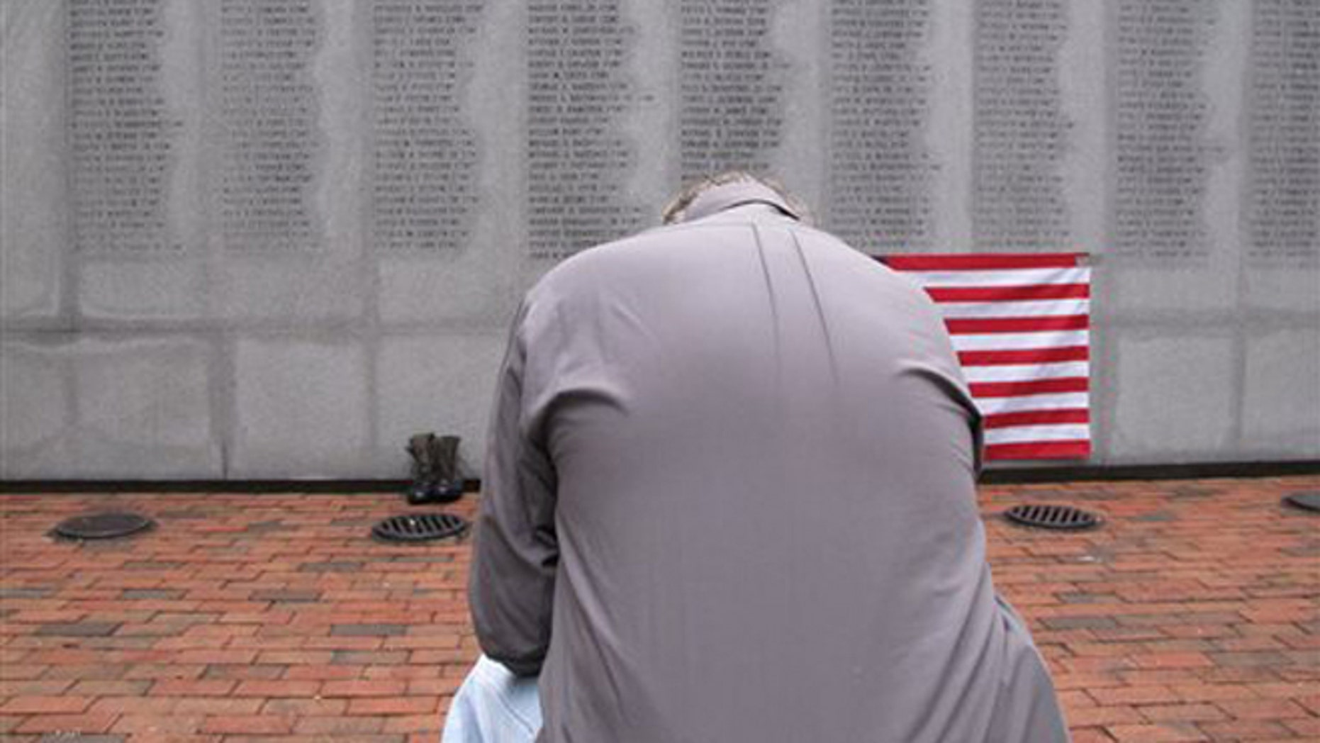 """Oct. 23, 2013: Former Marine Ed Ayers of Scranton, Penn., hangs his head and weeps at the Beirut Bombing Memorial in Jacksonville, N.C. Wednesday was the 30th anniversary of a terrorist bombing that killed 241 U.S. service members. Ayers, who did two tours in Lebanon, said the peacekeeping mission there was worth it but, """"I wish it was handled differently."""""""