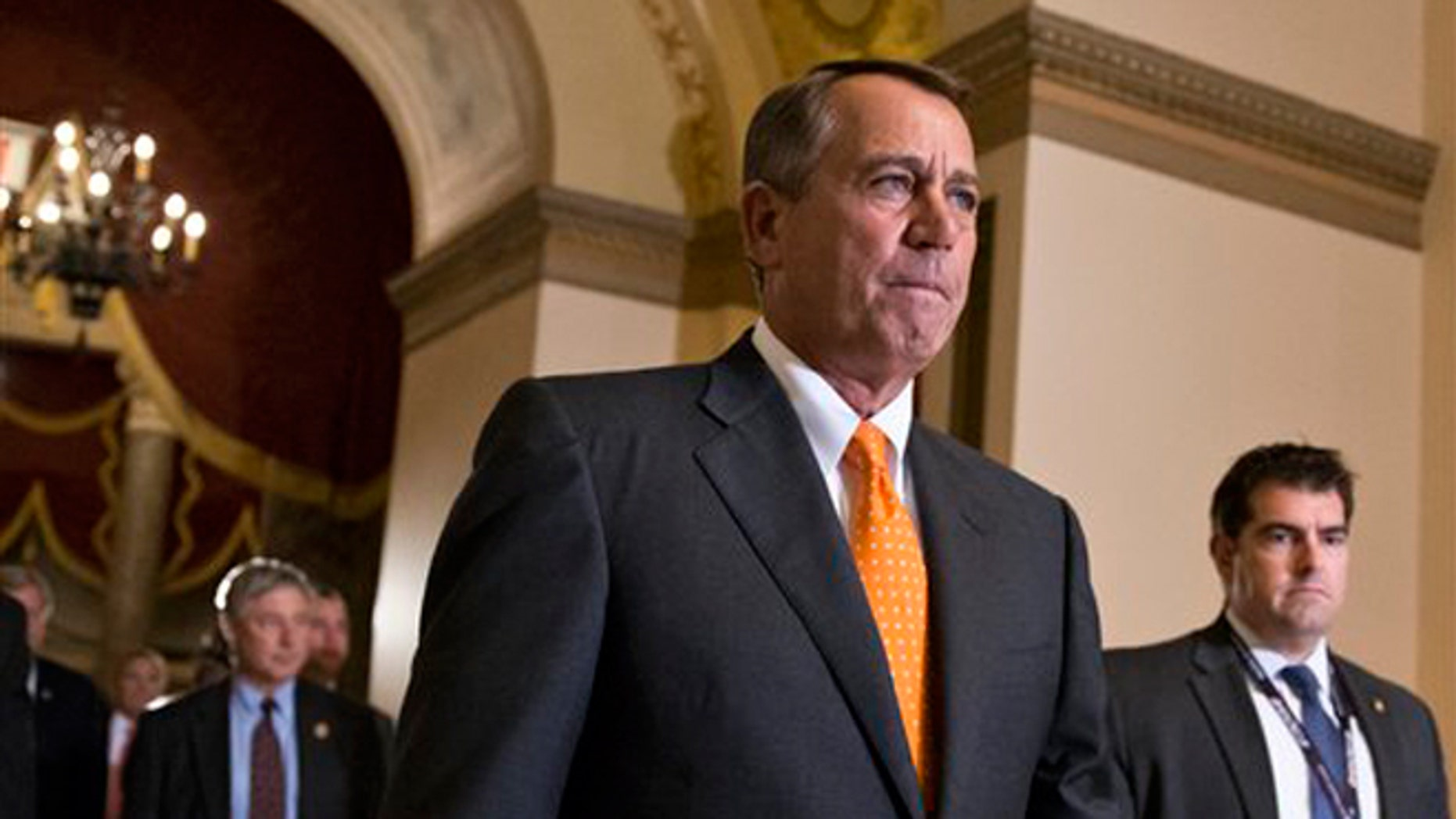 Oct. 16, 2013: Speaker of the House John Boehner, (R-Ohio), walks to the chamber for the vote on a Senate-passed bill that would avert a threatened Treasury default and reopen the government after a partial, 16-day shutdown, at the Capitol in Washington.