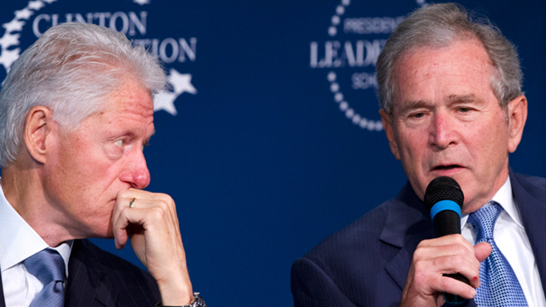 Sept. 8, 2014: Former President Bill Clinton listens at left, as fellow former President George W. Bush speaks at the Presidential Leadership Scholars Program Launch, at The Newseum in Washington. The two launched a new scholars program at four presidential libraries, aiming to help academics and business leaders learn more about presidential leadership.