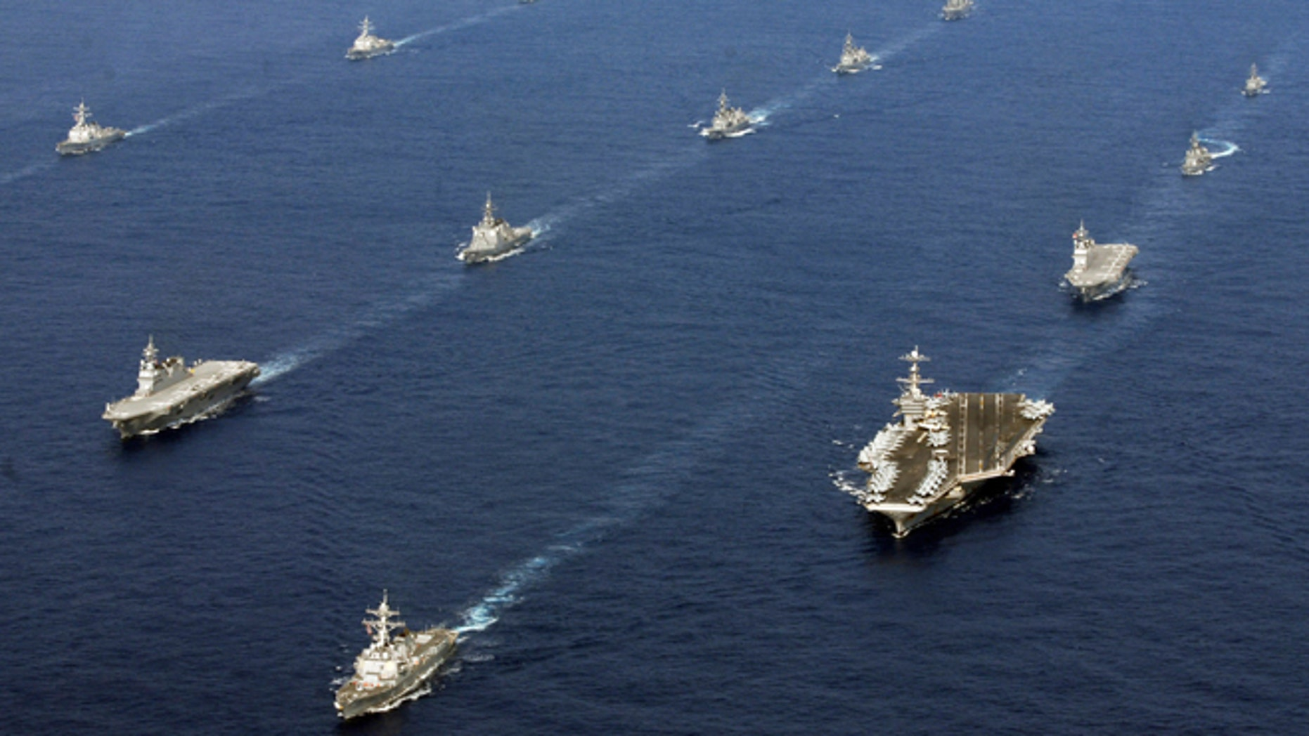 FILE -- Nov. 16, 2012: In this photo taken and released by U.S. Navy, twenty-six ships from the U.S. Navy and the Japan Maritime Self-Defense Force, including USS George Washington, bottom right, steam together in East China Sea after the conclusion of Keen Sword, a biennial naval exercise by the two countries to respond to a crisis in the Asia-Pacific region.